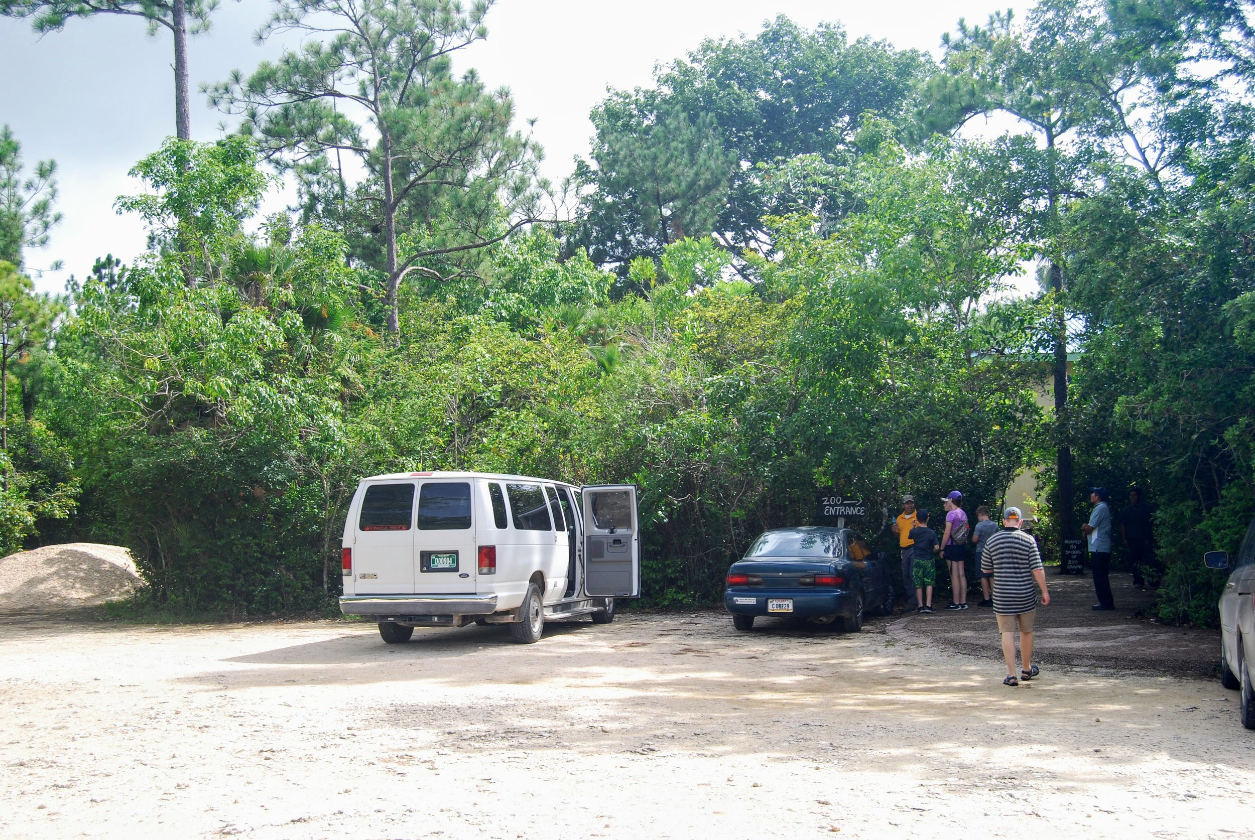 Parking lot and Zoo entrance. That's our van from William's Belize Shuttle on the left.