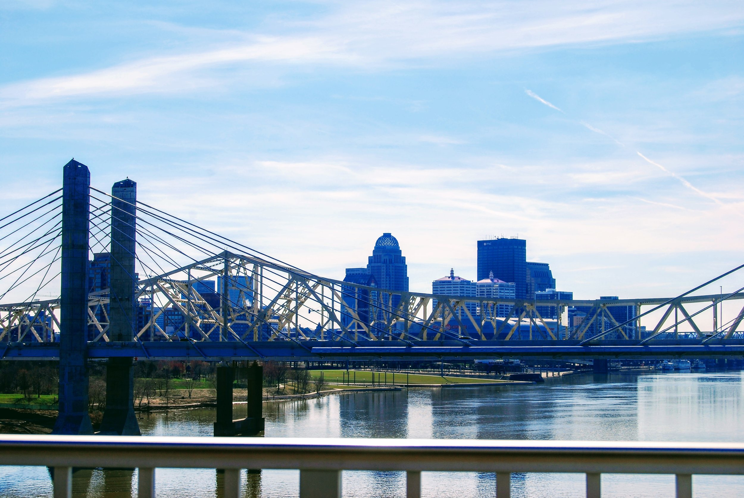 View of downtown Louisville and part of Waterfront Park from the Big Four Bridge.