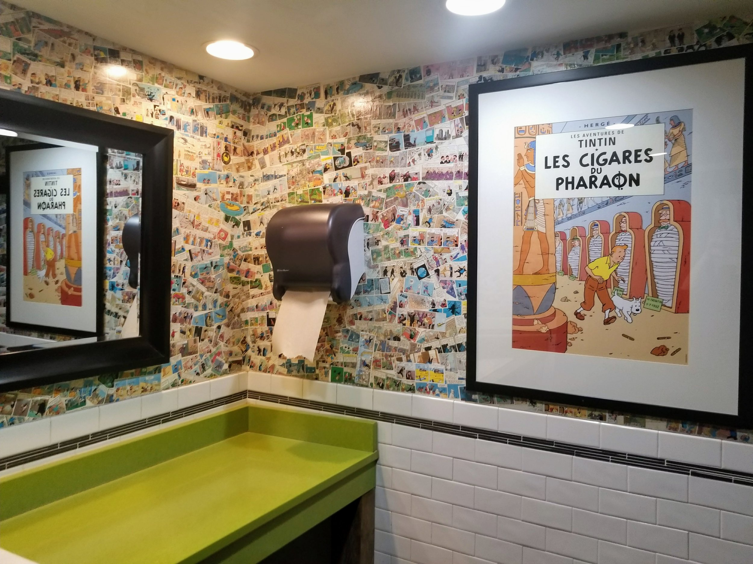 Tintin comics covering the walls of the bathroom in the Trappe Door