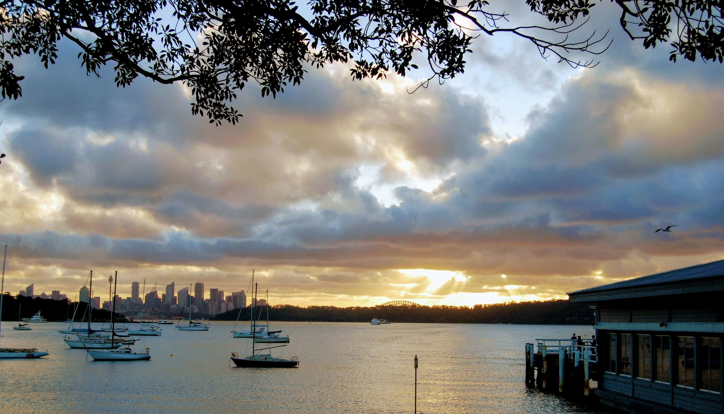 The sunset over Sydney behind the ferry wharf at Watsons Bay