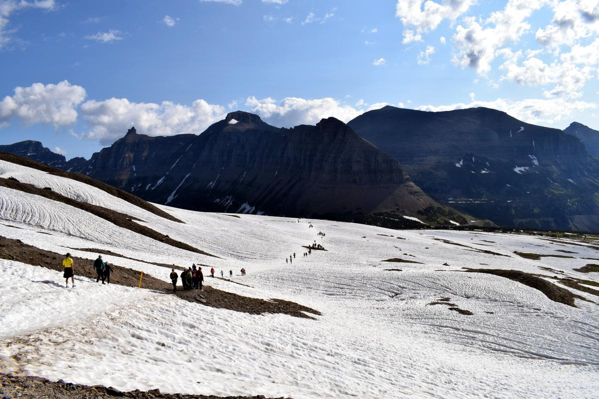 Hiking in snow on the Hidden Lake Trail on July 1