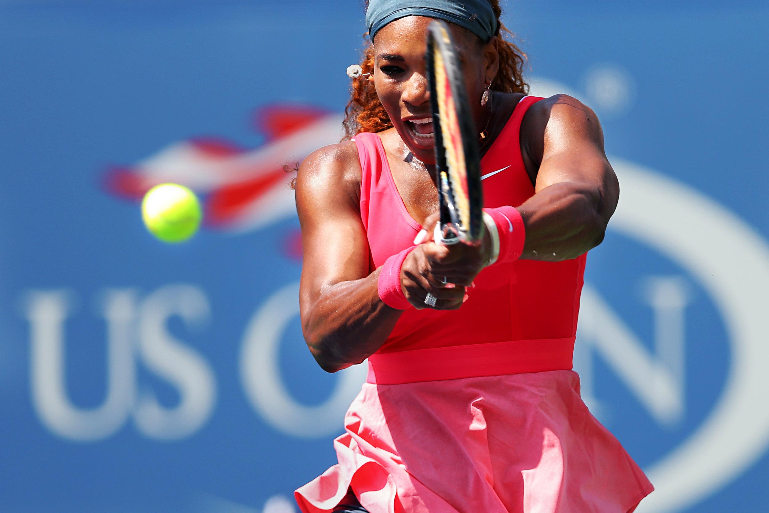 Serena Williams returns to Galina Voskoboeva during the women singles second round at the U.S. Open tennis tournament held at Arthur Ashe Stadium in Queens, Ny. Williams defeated Voskoboeva 6-3, 6-0.