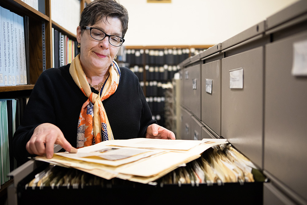 Commissioner at the New York City Department of Records and Information, Pauline Toole look through the NYC Homelessness records from the 1950s inside of The Municipal Archives reference library. The archive contains city documents such as birth certificates, official documents, and the Mayoral archive.