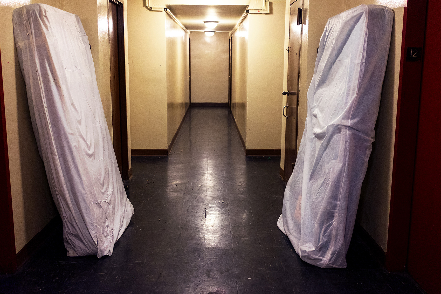 Mattresses containing bedbugs stand in the hallway of the 12 floor at the Ebbets Field Apartment complex. Robin Talyor lived on the 12 floor until she was evicted in 2015. Ebbets Field Apartments opened in 1962 after the Brooklyn Dodgers moved to Los Angeles providing affordable housing for low income families.