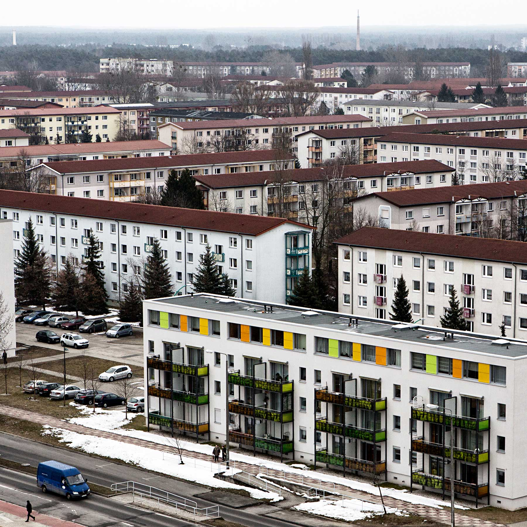 Apartment complexes built to keep up with the fast growing population of Hoyerswerda during the GDR. These buildings have been renovated by adding color and railings to make them more attractive to future residence.