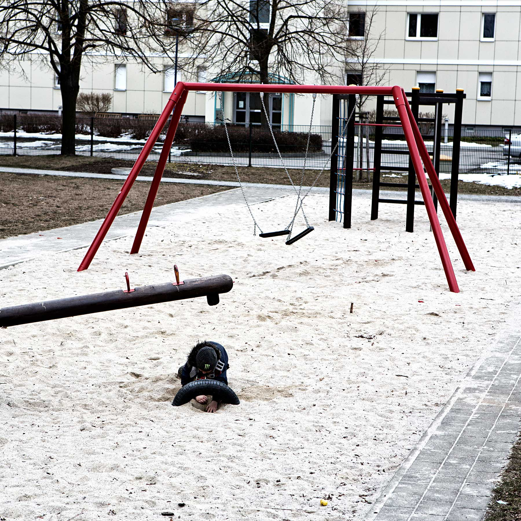 A young boy plays in the sand at a local playground.Hoyerswerda has plenty of playgrounds but most have just a few or no kids playing in them.