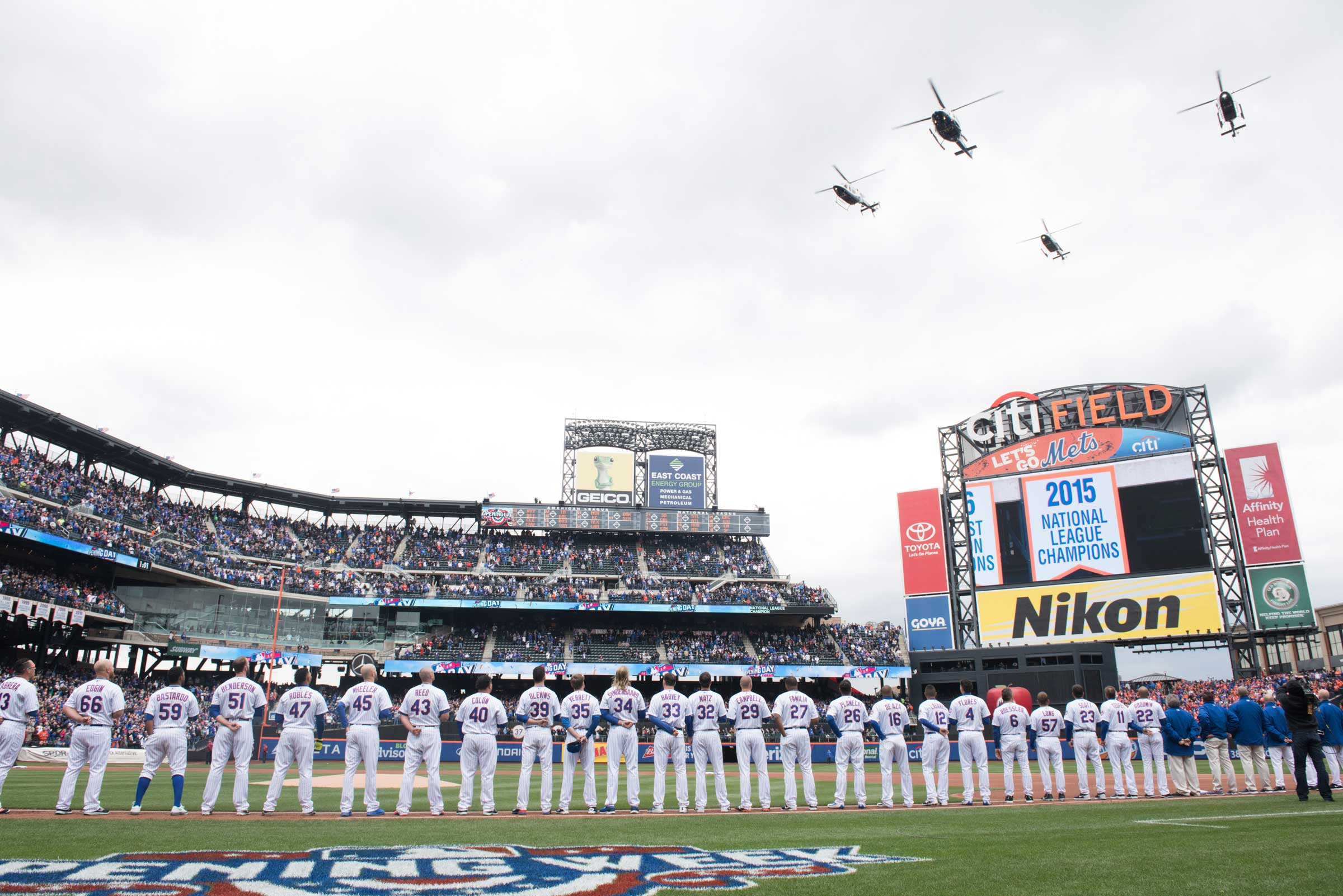 NYPD helicopters fly over Citi Field at the opening day ceremony for the New York Mets.