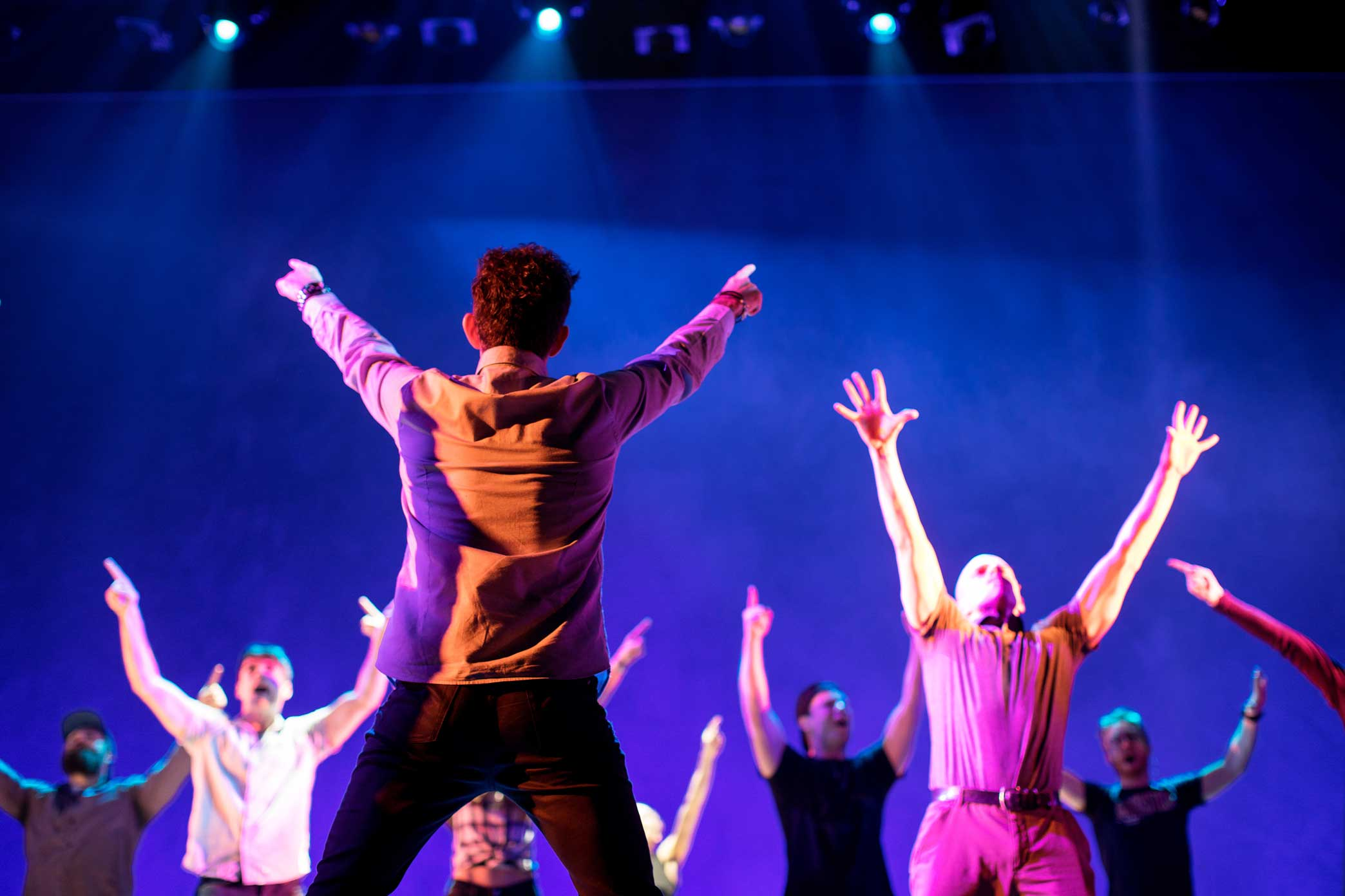 """Director Andy Blankenbuehlerr demonstrates a dance move correction for the Broadway Musical """"Bandstand"""" cast during the last rehearsals at the Bernard B. Jacobs theater in Manhattan."""