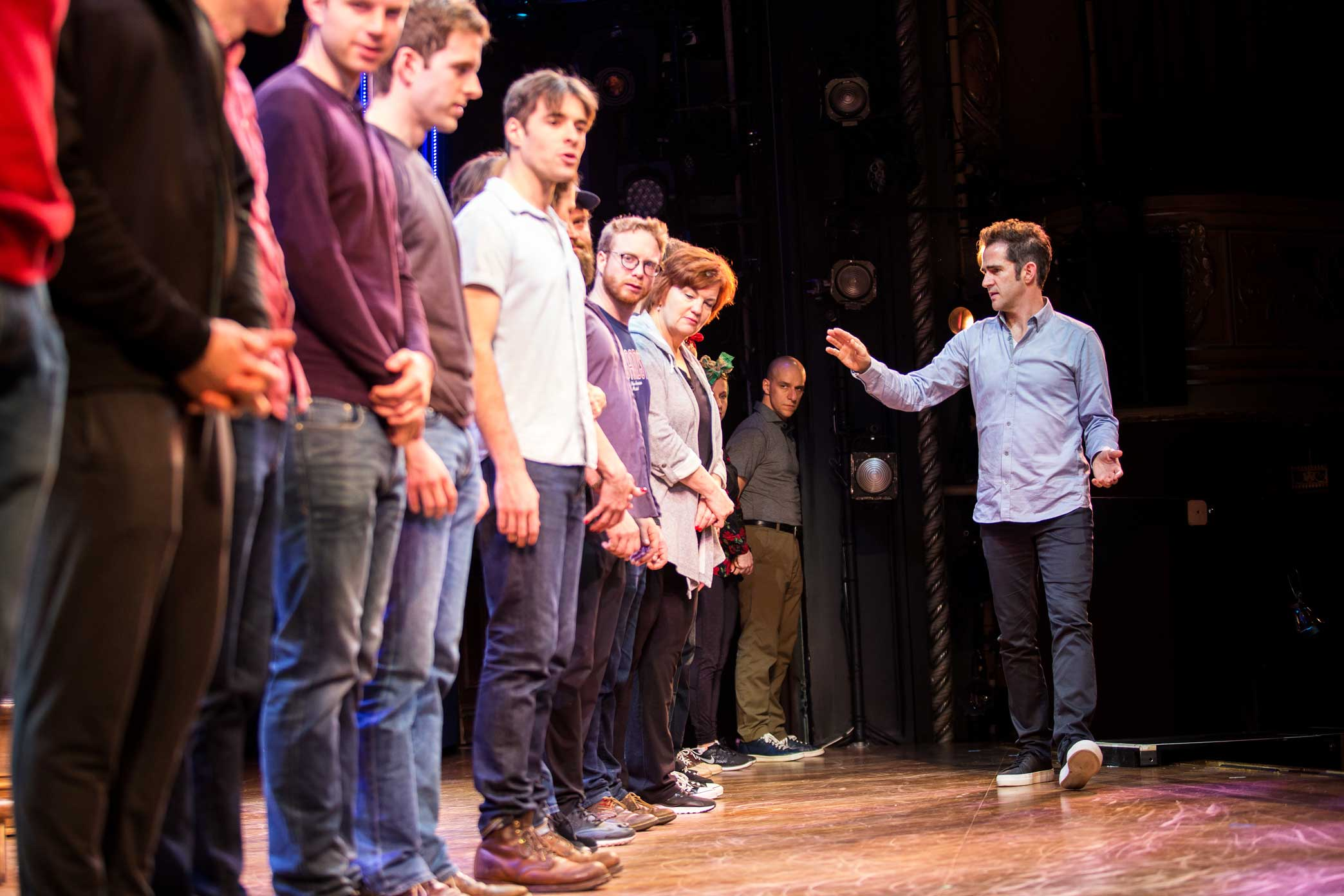The cast lining up to rehearse the curtain call.  1:10 p.m.Mr. Blankenbuehler spent almost an hour fleshing out a fully choreographed curtain call for the first time. He repeatedly moved actors in and out of position and asked for shifts in lighting as they tried out their cues.