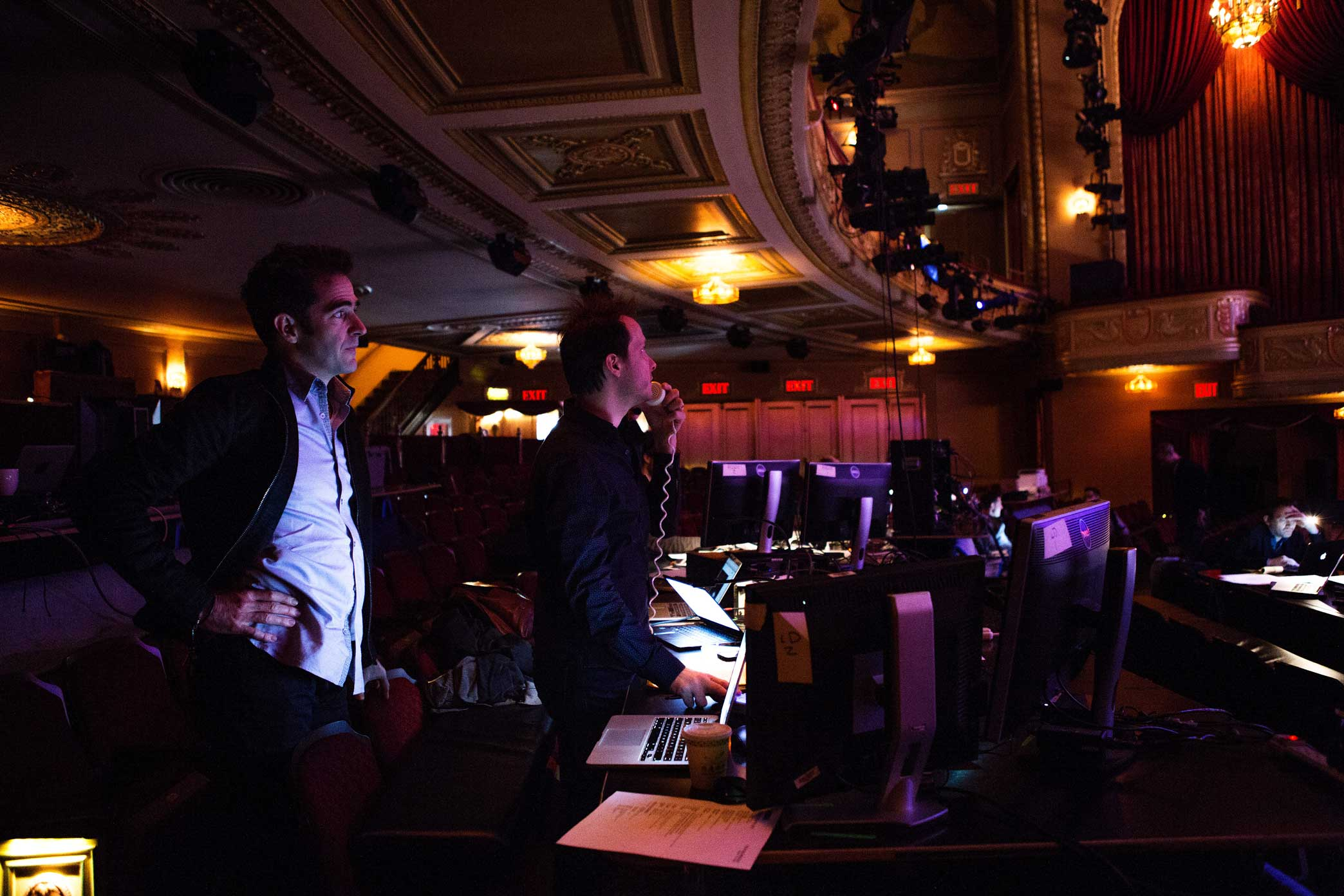 """Mr. Blankenbuehler, left, with the lighting designer Jeff Croiter.  11:48 a.m.For the first fix of the day, Mr. Blankenbuehler had to figure out why light and actor weren't gelling in a """"button,"""" a tiny moment that signals to the audience that an element in the show is over. He consulted with the lighting designer, Jeff Croiter, on how best to handle a first-act transition in the number """"You Deserve It,"""" set at a bar and involving the actor Drew McVety and the ensemble."""