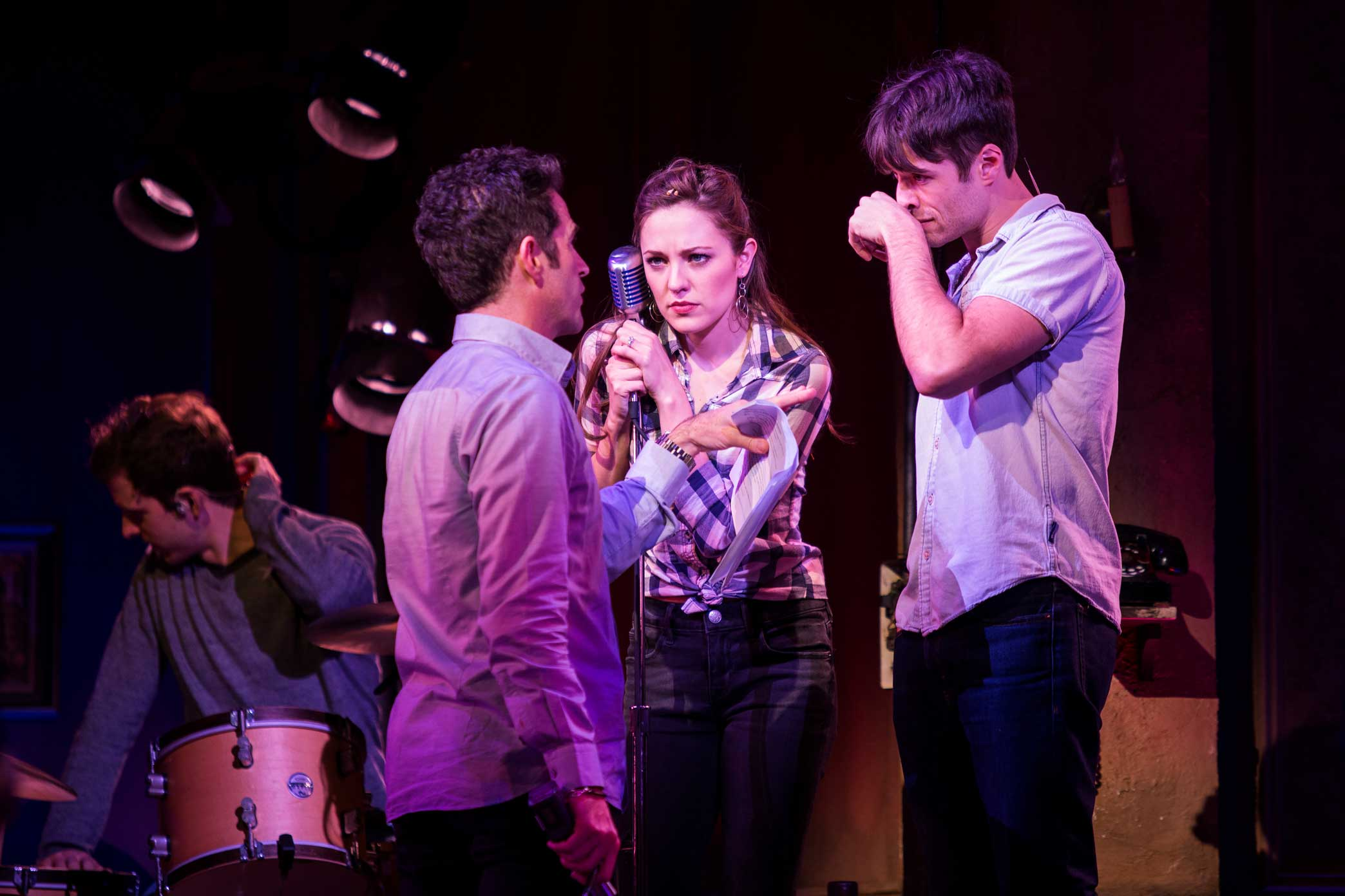 """Mr. Blankenbuehler, left, with the actors Laura Osnes and Corey Cott.  2:05 p.m.Repeated calls of """"Five, six, seven, eight"""" echoed throughout the theater as Mr. Blankenbuehler figured out the right way to properly light Ms. Osnes and Mr. Cott as they came into position during a number featuring an onstage microphone. He then spent about 10minutes making tiny adjustments to a complicated-looking dance sequence, finessing over and over the dancers' leg extensions and speed as they sang the lyrics """"the boys are back."""" In the show the moment lasted all of about three seconds."""