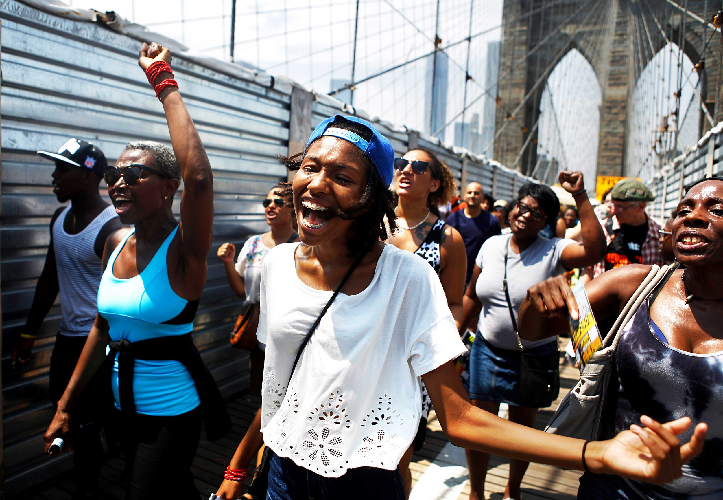 "After attending a rally in Manhattan in honor of Trayvon Martin, many marched across the Brooklyn Bridge chanting ""What do we want? Justice!""   The rally and march came one week after George Zimmerman was found not Guilty for the death of Trayvon Martin in 2012."