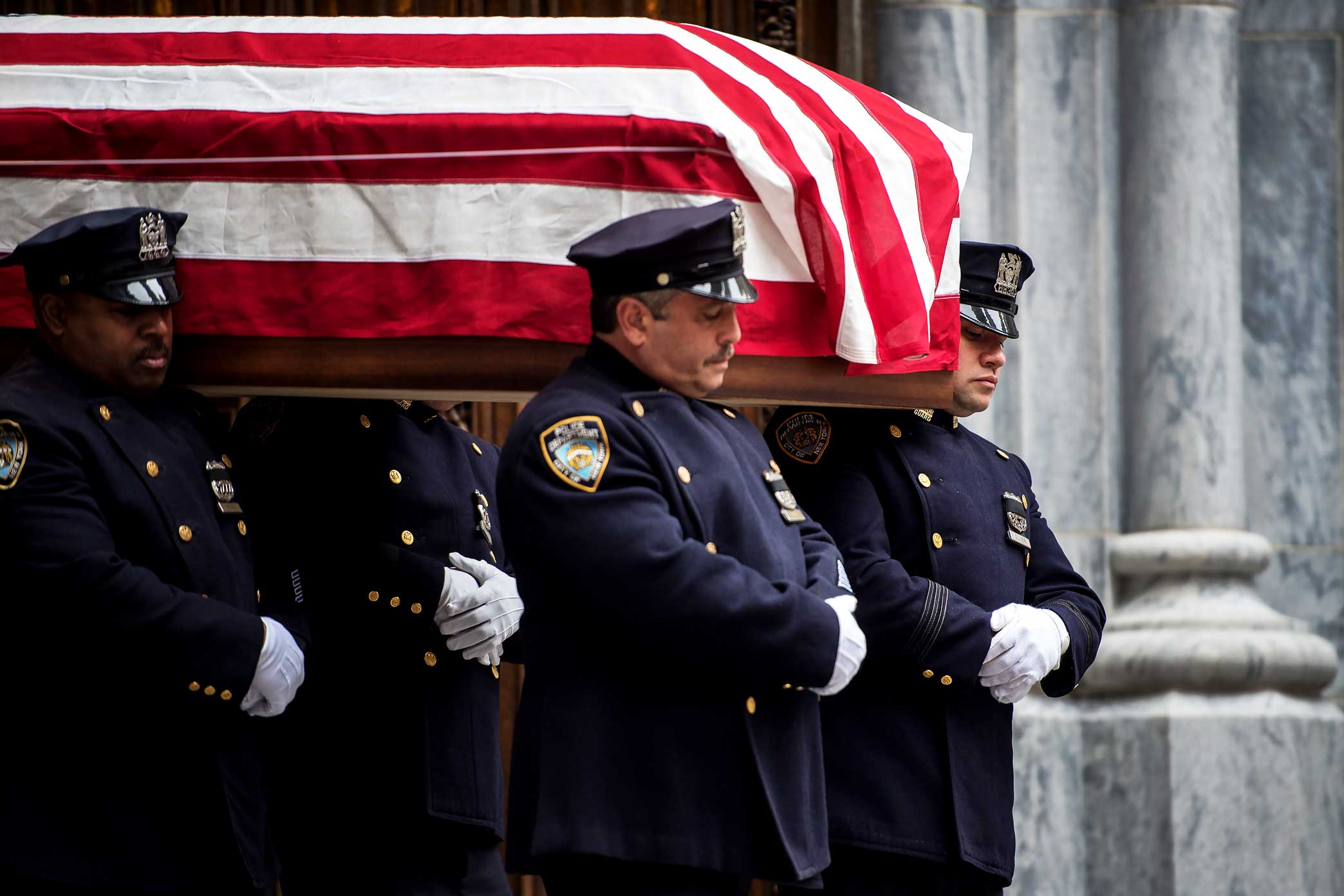 NYPD Police Officers carry and salute NYPD Detective Joseph Lemm at St. Patrick's Cathedral in Manhattan, New York. Detective Lemm was killed by a suicide bomber while serving in the Air National Guard in Afghanistan.