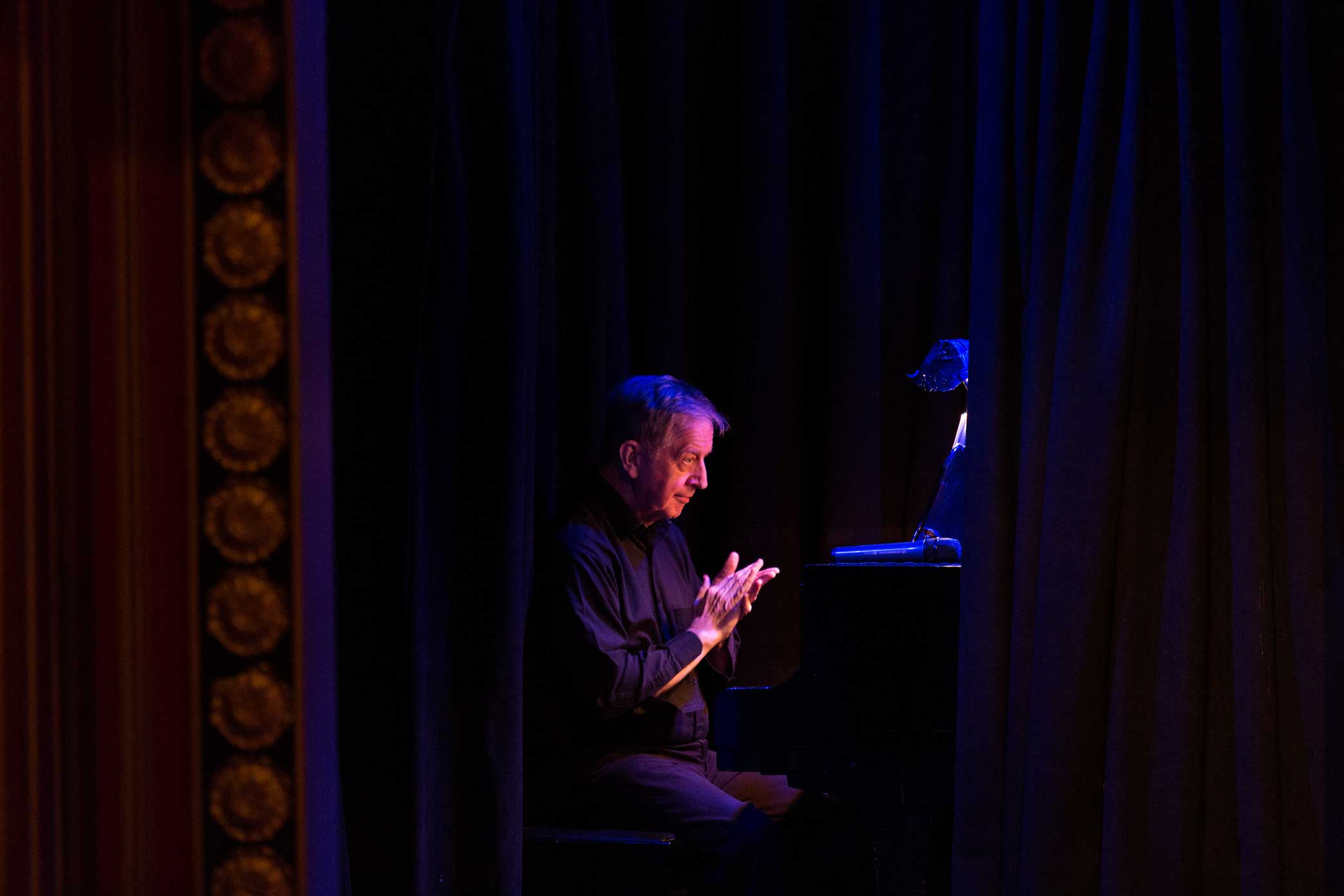 Musical Director, Fred Barton at thew piano before the start of Spamilton: An American parody and musical of the Broadway show Hamilton at The Triad in Manhattan.