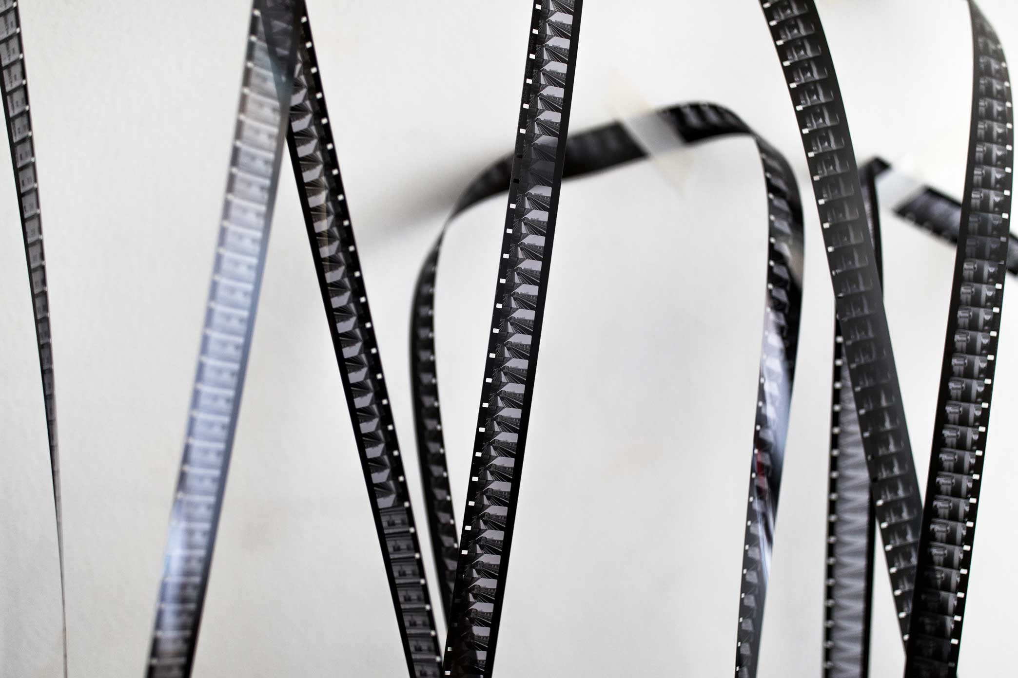 Strips of film hang on the wall of the Mono No Aware workshop space in Brooklyn.