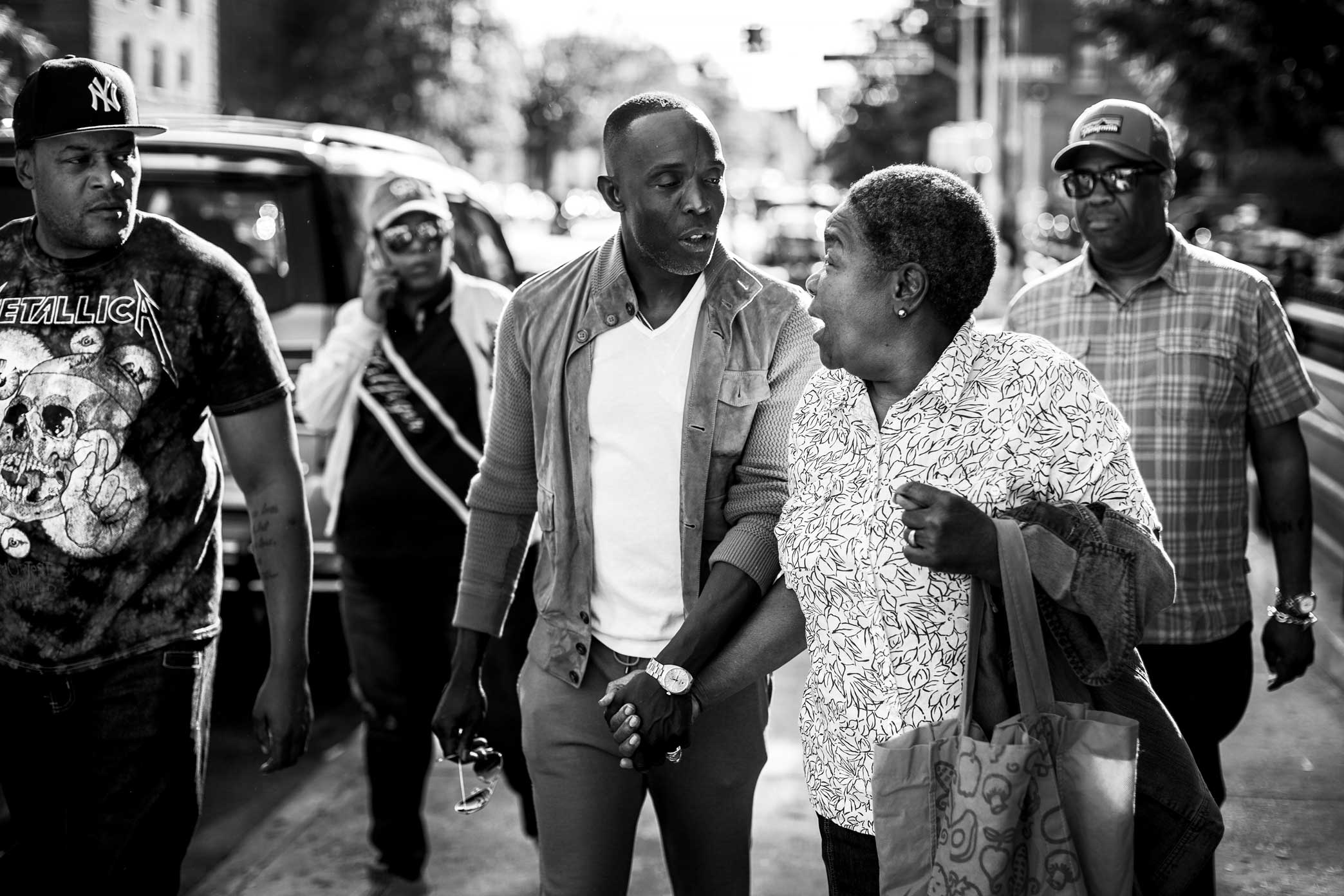Michael K. Williams with residents of East Flatbush, Brooklyn, where he grew up.