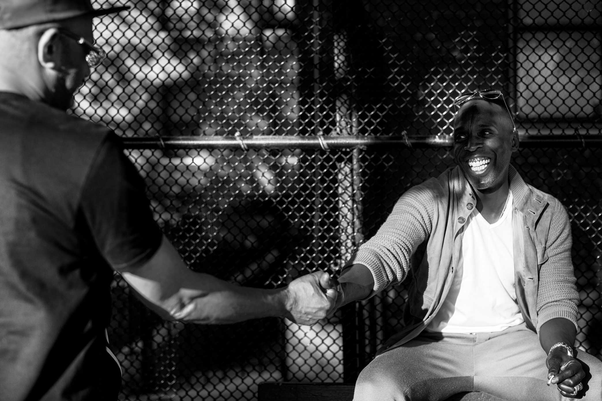 """Mr. Williams hanging out at the Norstrand Ave basketball court in Flatbush Brooklyn. """"It has been way too long since I was last there,"""" said Williams. Williams grew up in Vanderveer Projects now named Flatbush Gardens in Flatbush Brooklyn.  Weed"""
