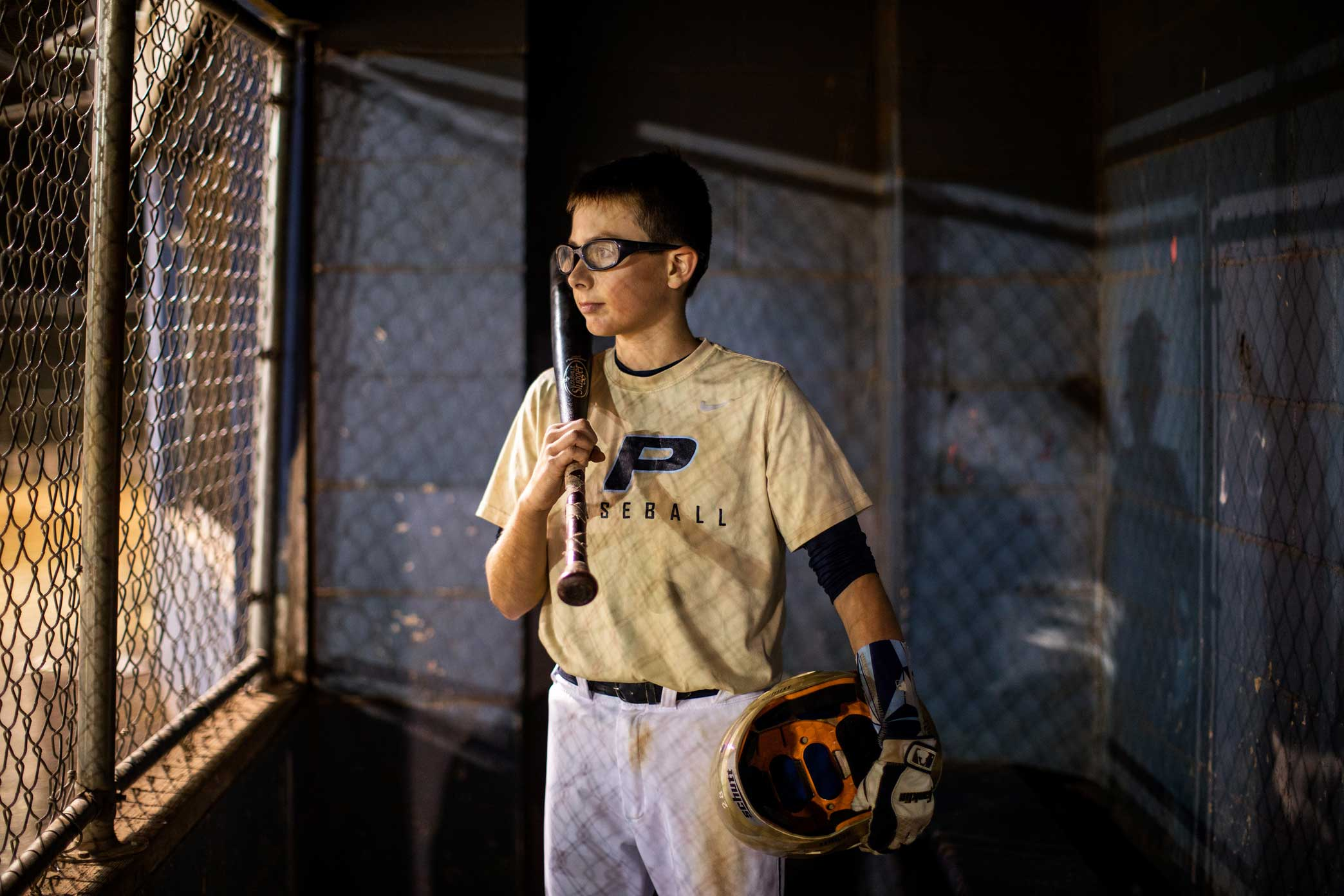 Alex Miller in the dugout at the New Springville Little League complex in Staten Island, New York.