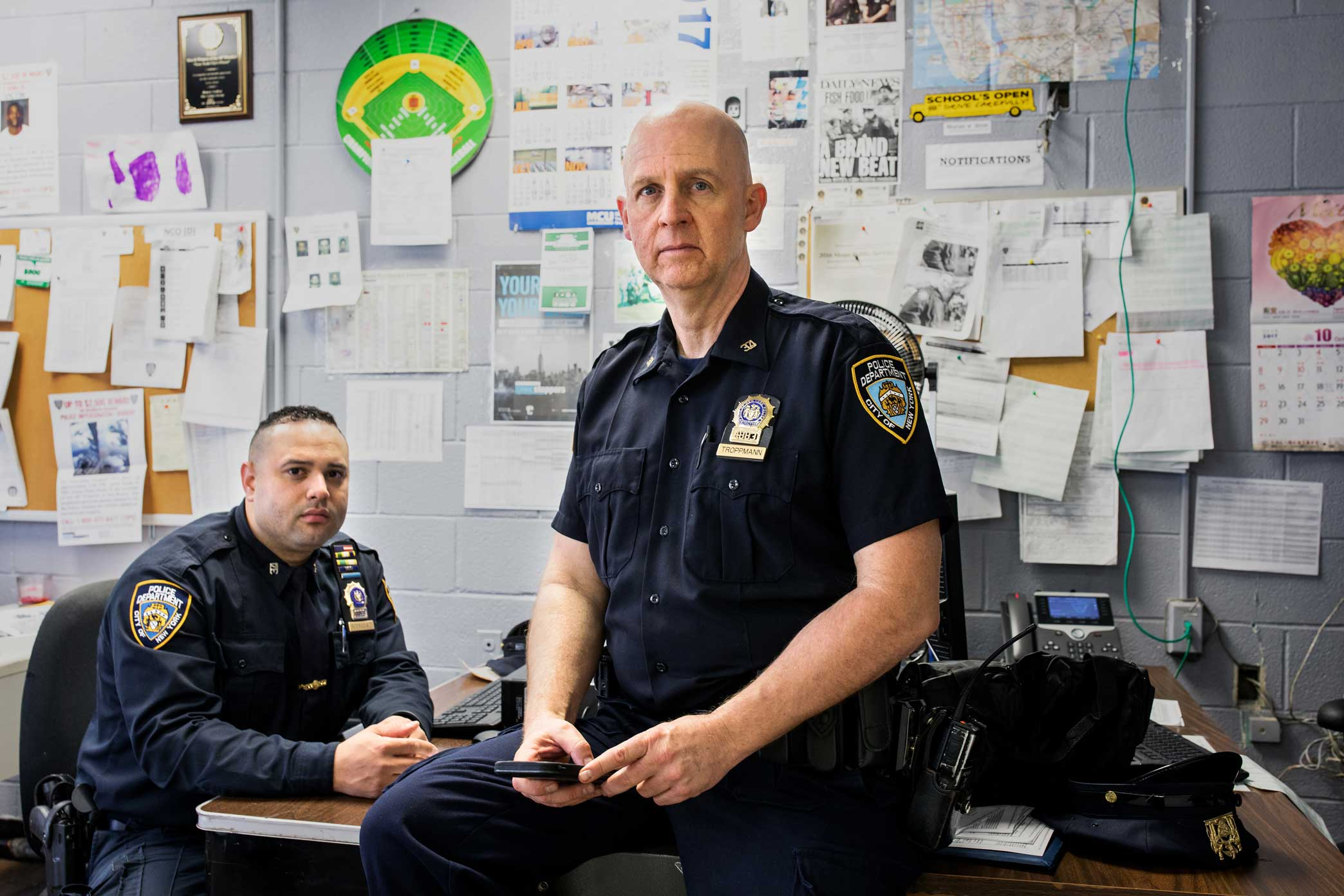 Detective Specialist Thomas W. Troppmann, center, and his partner Detective Specialist Edwin A. Rodriguez at the 34th Precinct in Upper Manhattan.Rodriguez and Troppmann are Neighborhood Coordinating Officers in the precinct who interact directly with the surrounding community in order to improve police and community relations to reduce crime.  Story link  here .