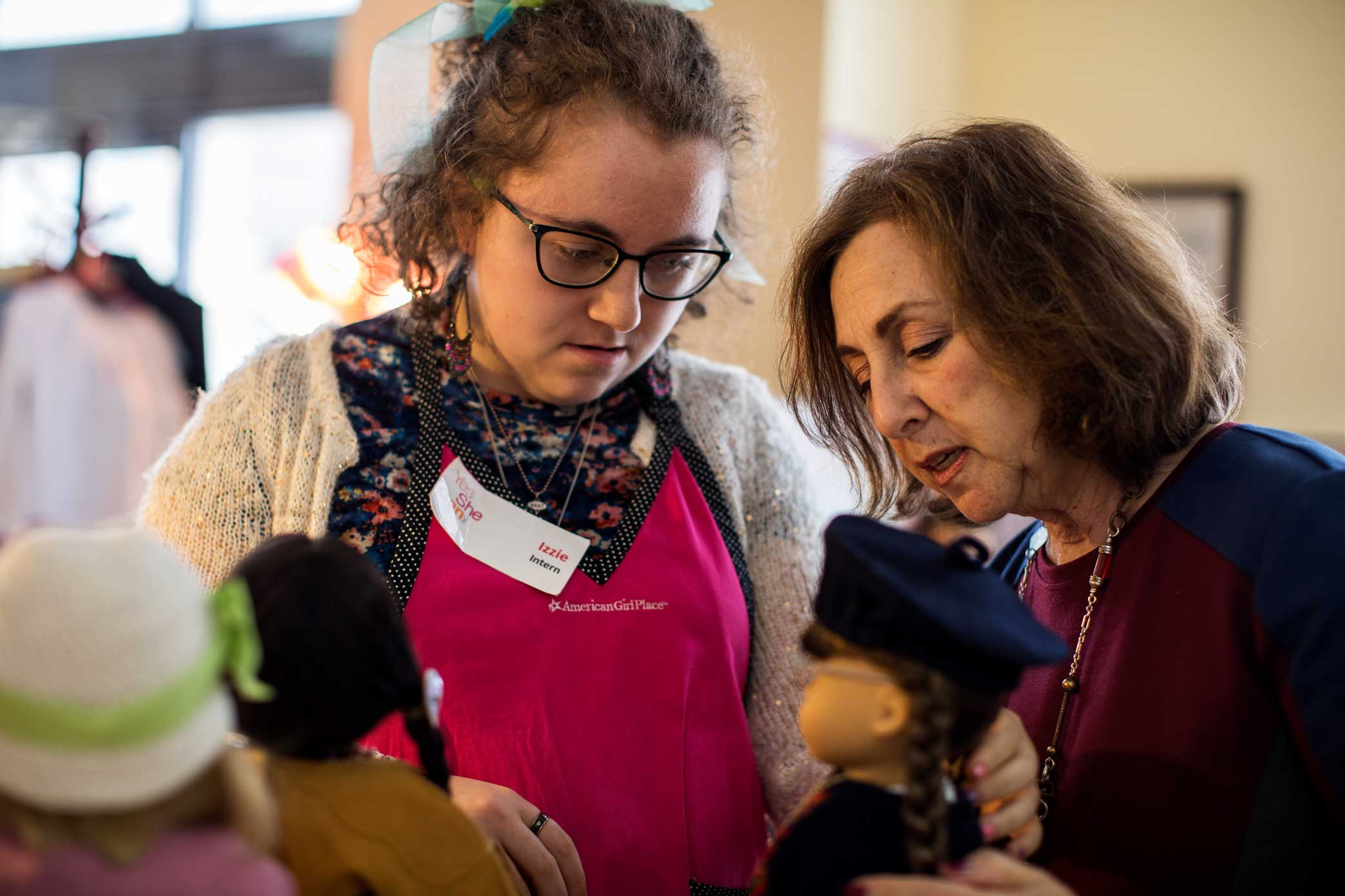 President and Executive Director of Yes She Can Inc, Majorie Madfis work with her daughter Isabelle at her resale boutique for American Girl Dolls store Girl A Gain in White Plains, New York.