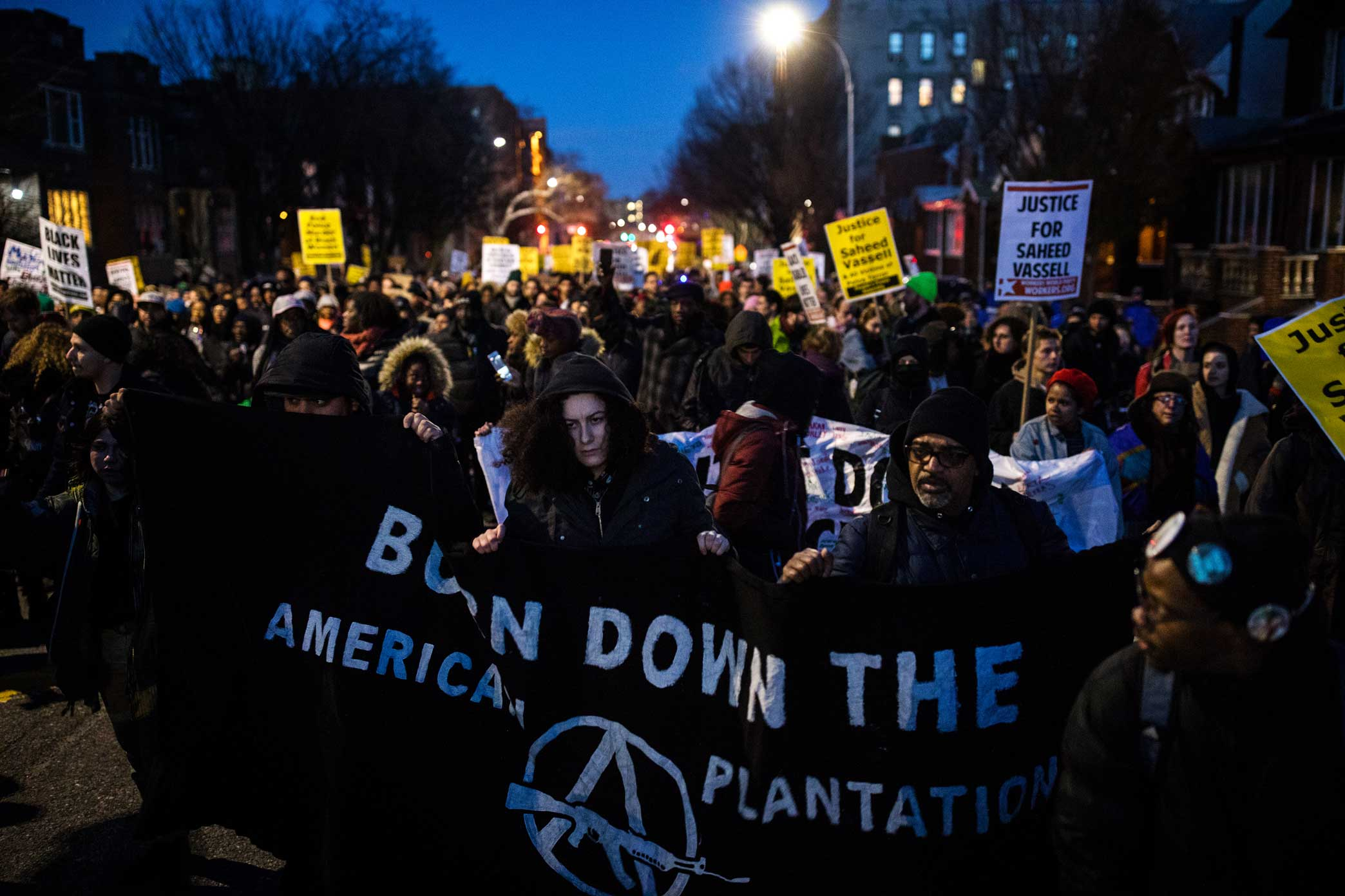 Protesters march in the street to the New York City Police Department - 71st Precinct in Brooklyn.