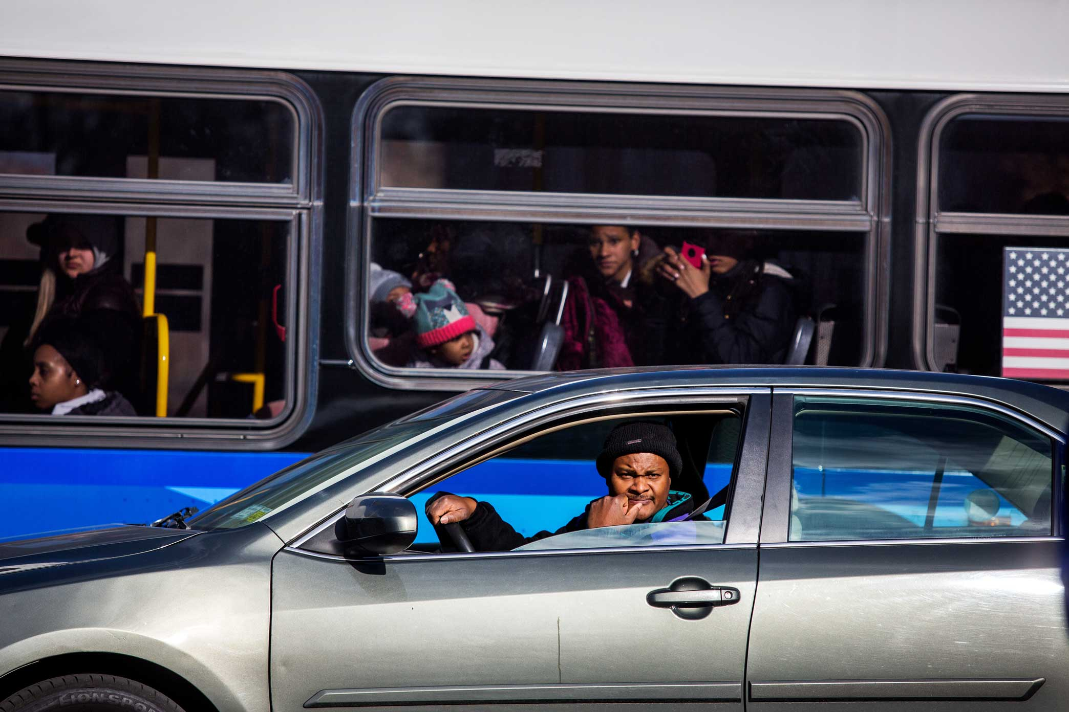 Commuters watch the protesters chant and protest the shooting death of Saheed Vassell.