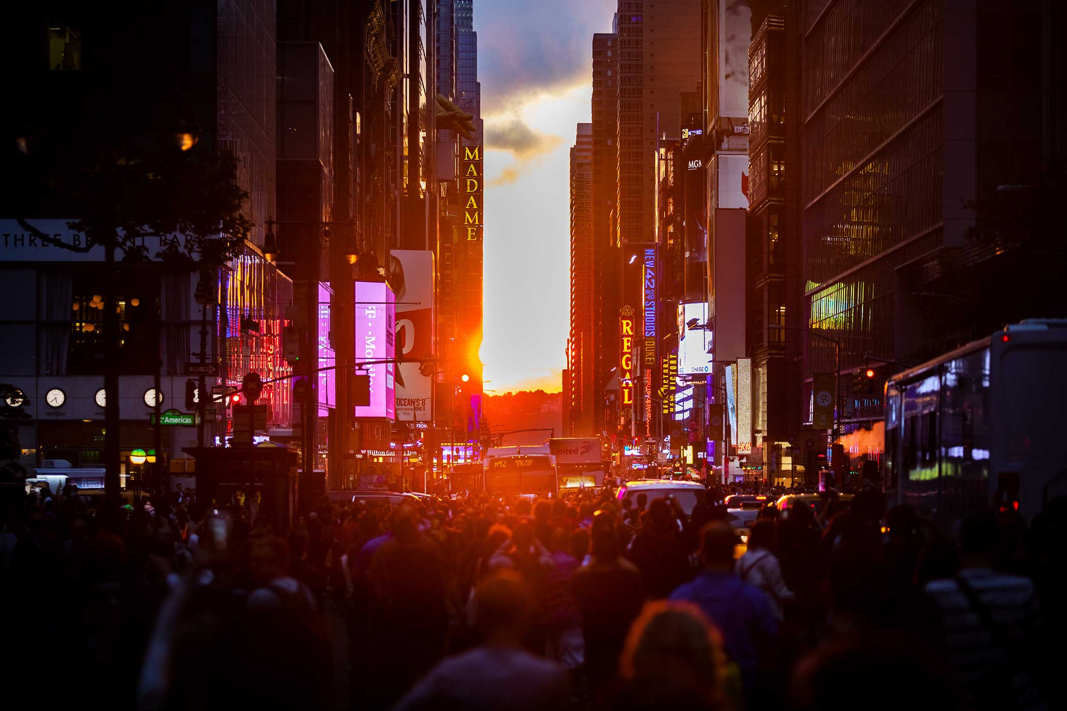 The sun sets over 42nd street in New York.