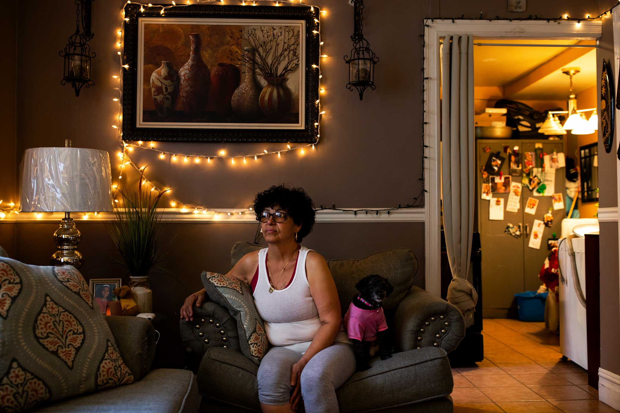 Awilda Garcia sits in her apartment at the Wald Houses in New York's East Village.