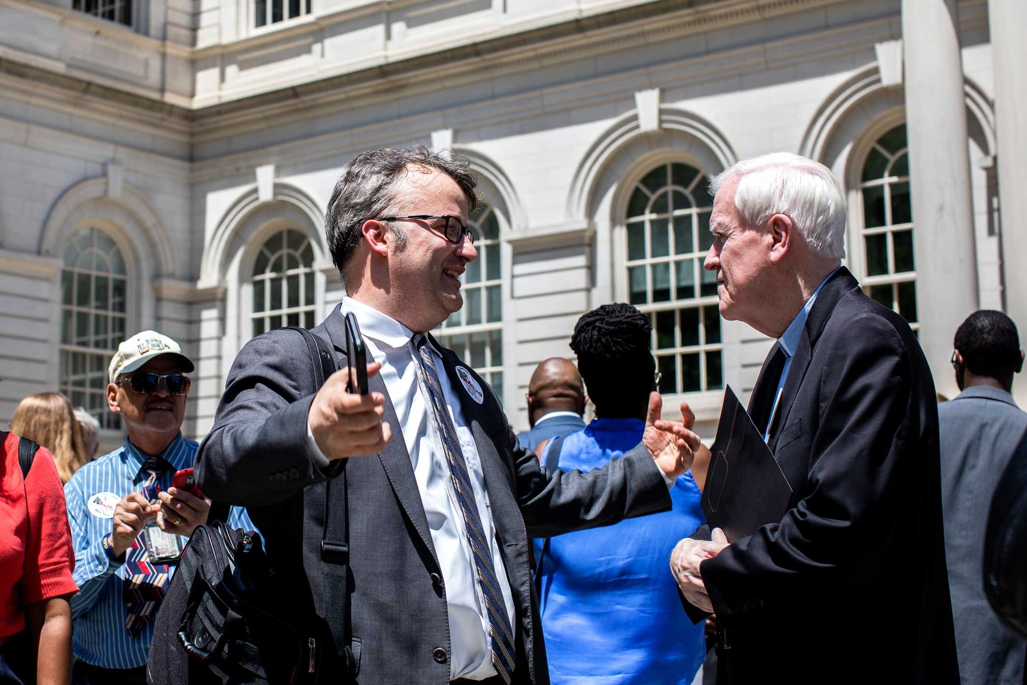 Stanley greets Reverand Francis Skelly, from the Immaculate Conception Church in the South Bronx, after the rally.