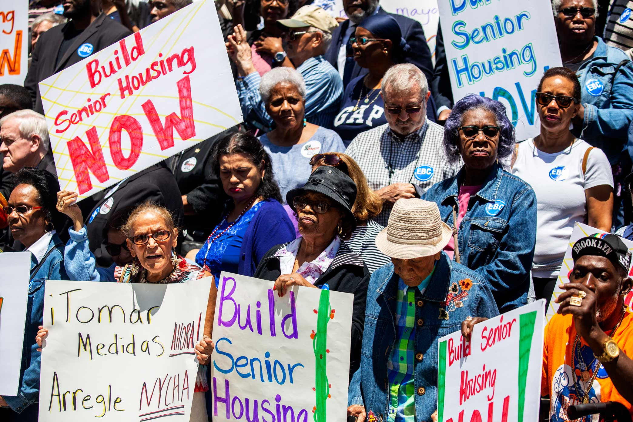 Community members rally at New York's City Hall to voice concerns about senior housing and NYCHA repairs, June 12, 2018.