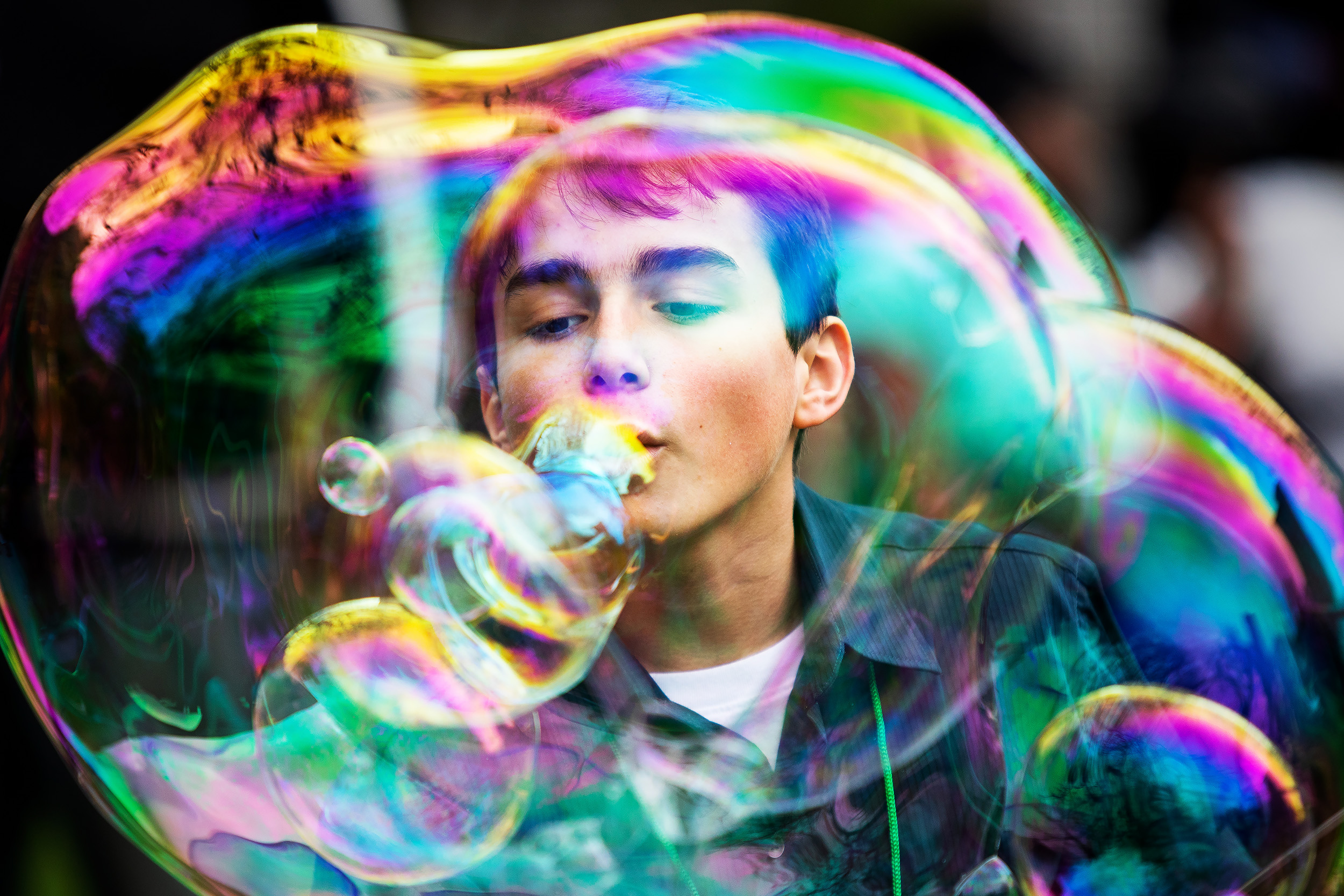 A young boy blows bubbles within bubbles for entertainment during the kickoff of Senator Cory Booker, a Democrat from New Jersey and 2020 presidential candidate, 'Justice for All' campaign tour in Newark, New Jersey