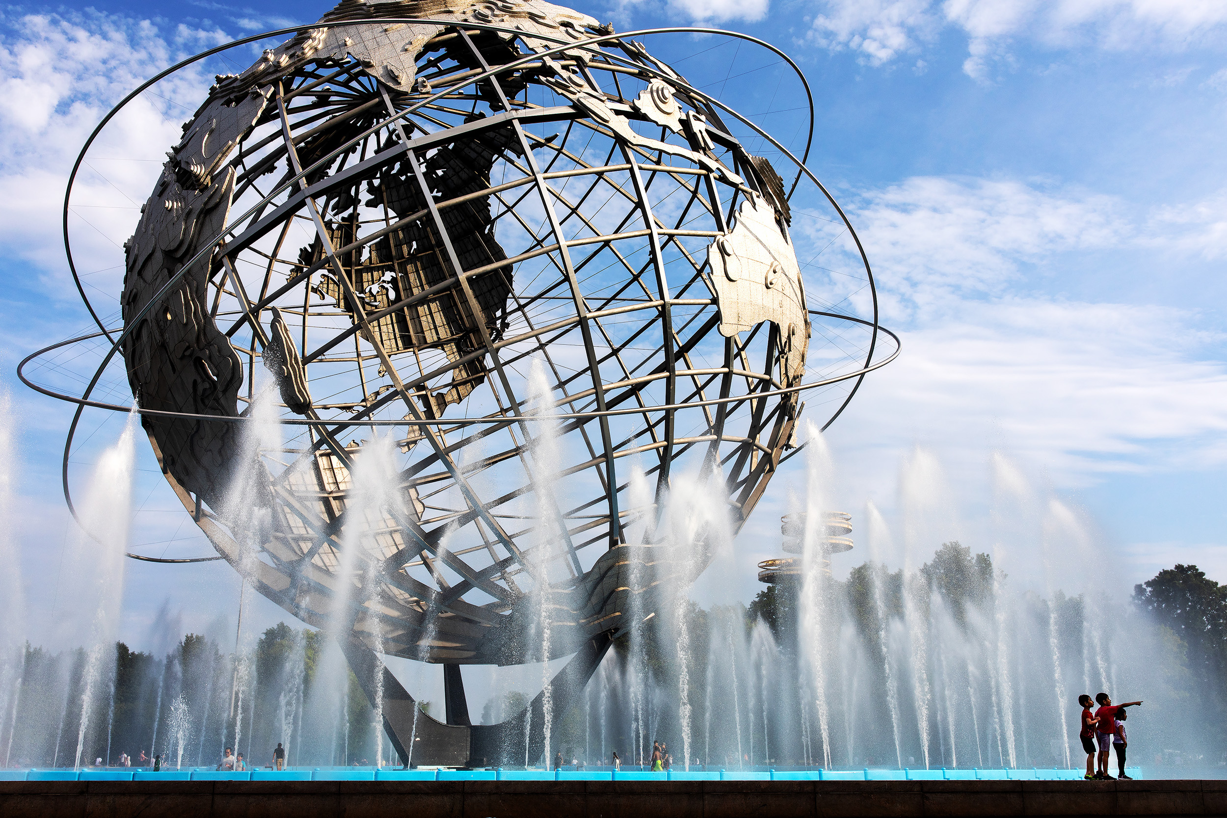 Kids play in the Unisphere fountain at the Flushing Meadows–Corona Park in Queens, New York.