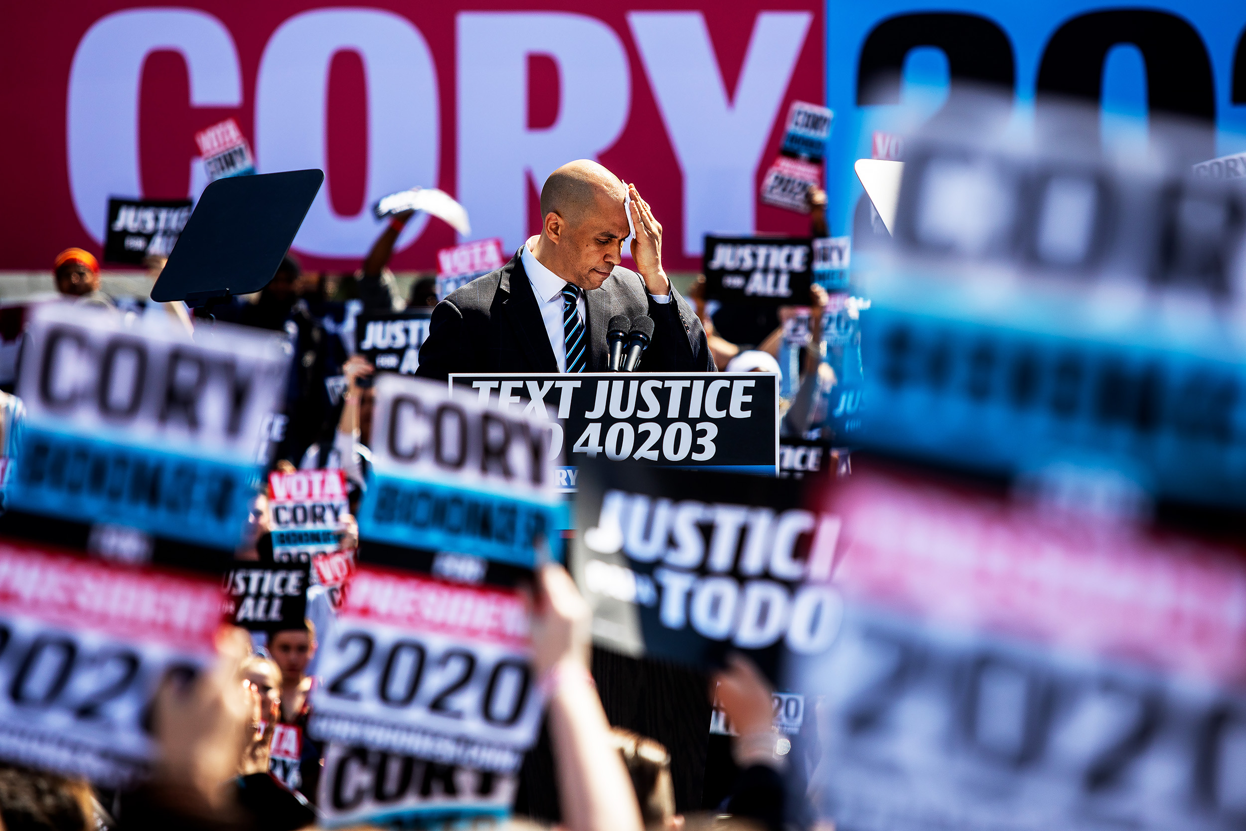 Senator Cory Booker, a Democrat from New Jersey and 2020 presidential candidate, wipes sweat from his face during the kickoff of his 'Justice for All' campaign tour in Newark, New Jersey.