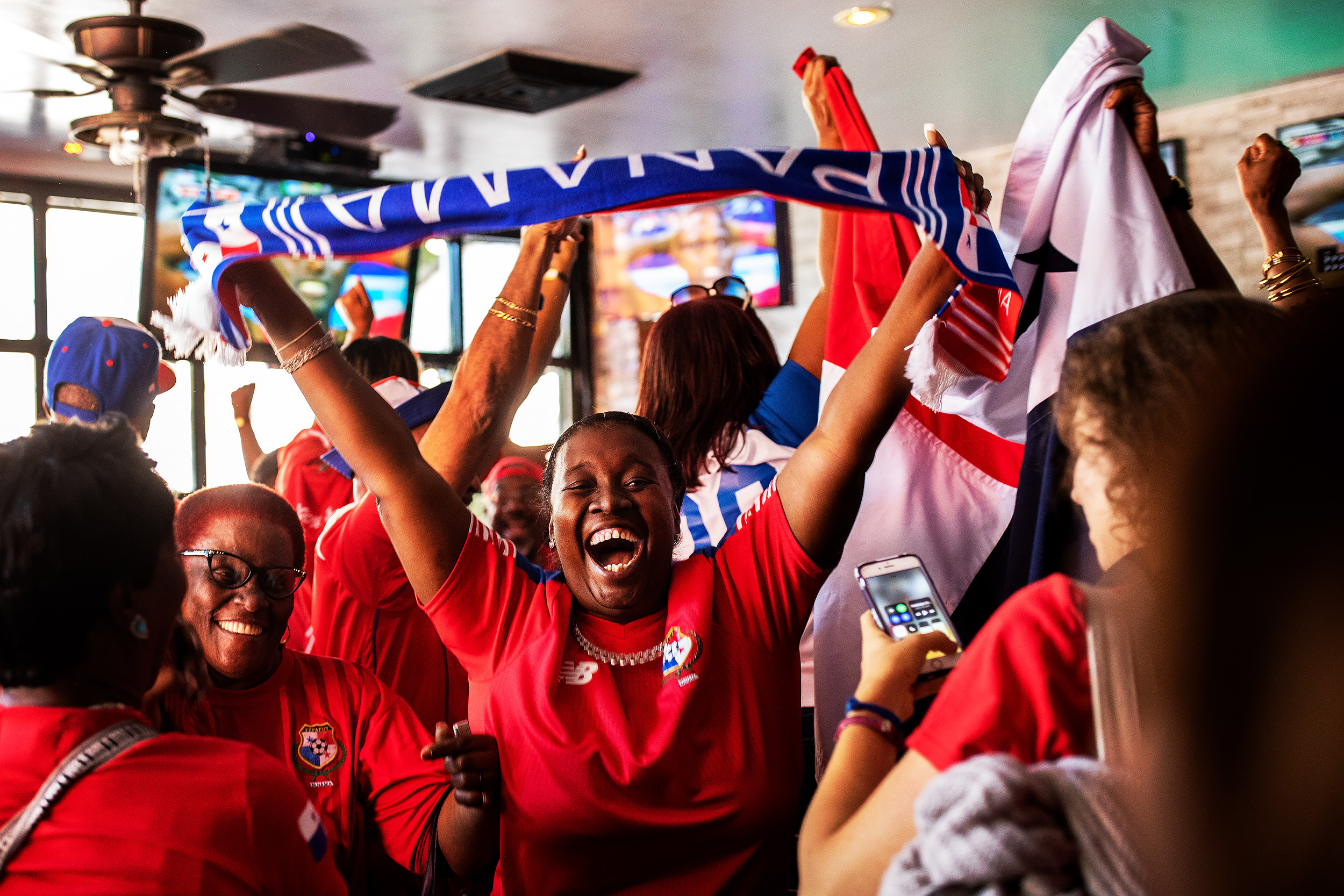 Fans celebrate Panama scoring a goal during the World Cup game between Panama and Tunisia at Michelle's, a Panamanian restaurant/bar, in Brooklyn, New York.