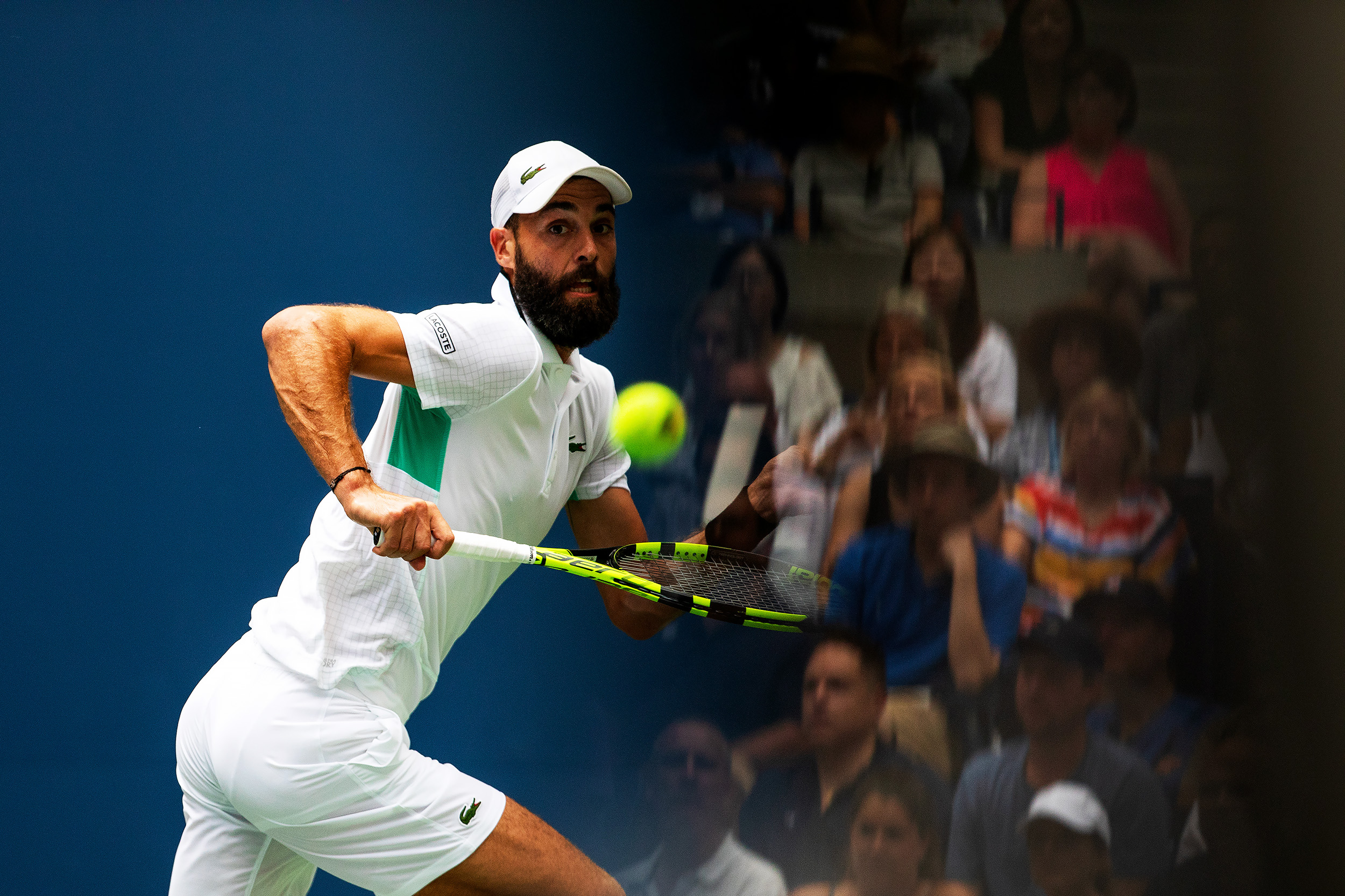 Benoît Paire of France chase down a Rodger Federer of Switzerland return during the 4th day of matches at Arthur Ashe Stadium in Queens, New York.