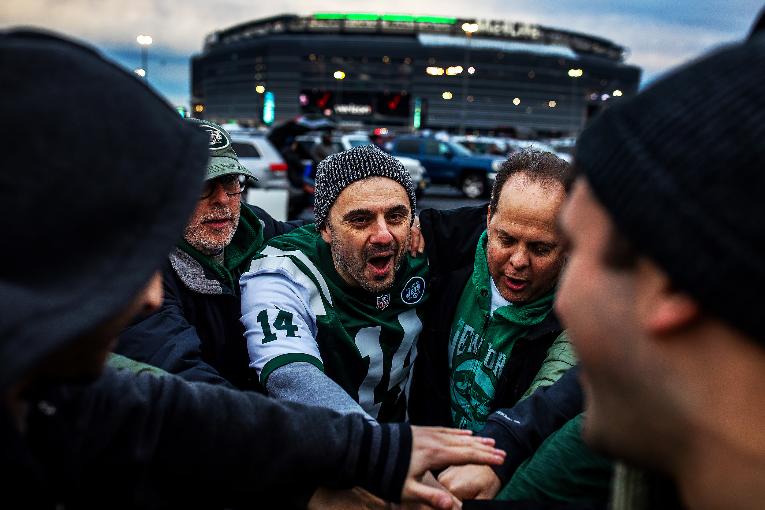 Entrepreneur and New York Jets fan, Gary Vaynerchuk, center, huddle with his friends during tailgating before the New York Jets and Houston Texans game at MetLife Stadium in Rutherford, NJ.
