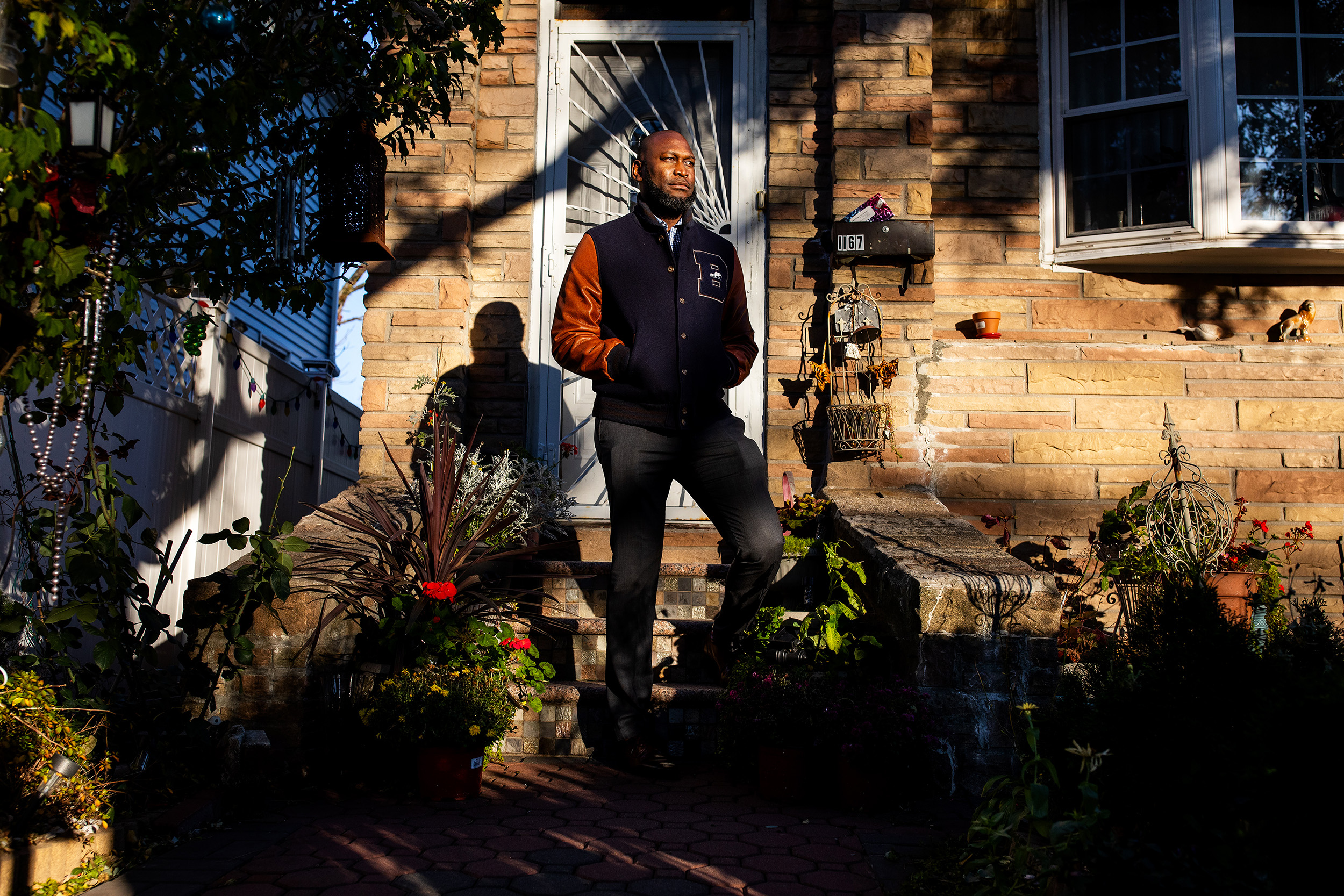 Commissioner of the NYC Department of Small Business Services, Greg Bishop outside of his mothers home in Brooklyn, New York.