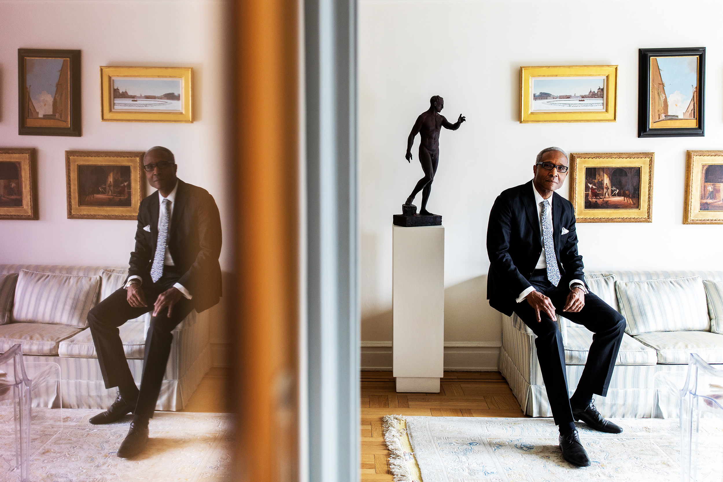 Senior corporate attorney, Gregory Peterson at his apartment in Manhattan, New York. Gregory is part of Columbia University's Class of 1973, the first graduating class of affirmative action students at the school. Gregory is an avid art collector and his apartment is filled with paintings, drawings and sculptures.