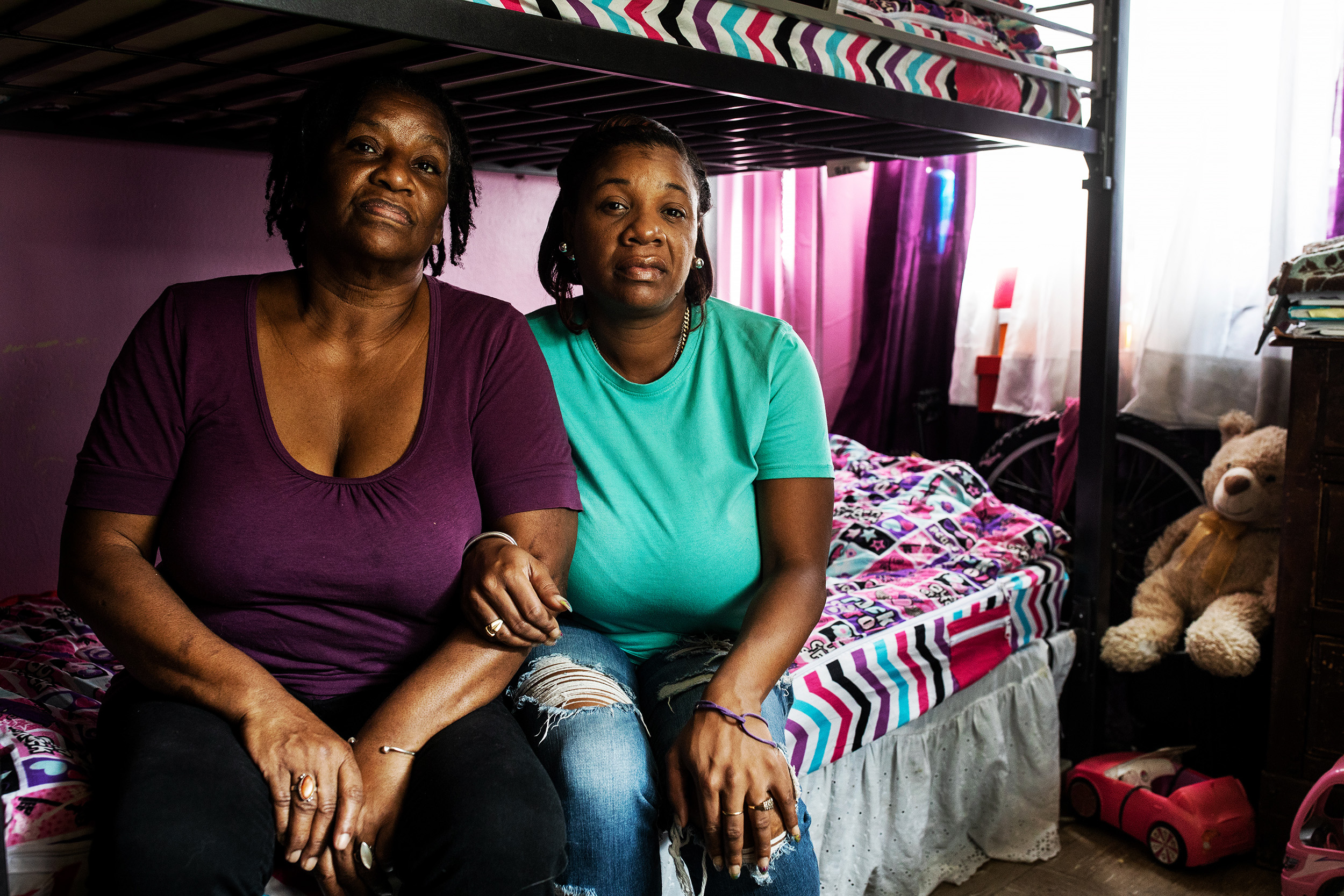 Jamila Cox, right, and Robin Parks at their apartment in Astoria Queens, New York. Jamila is a foster mother who took in a little girl and baby boy who lived next door after the children mother was killed in January 2017.