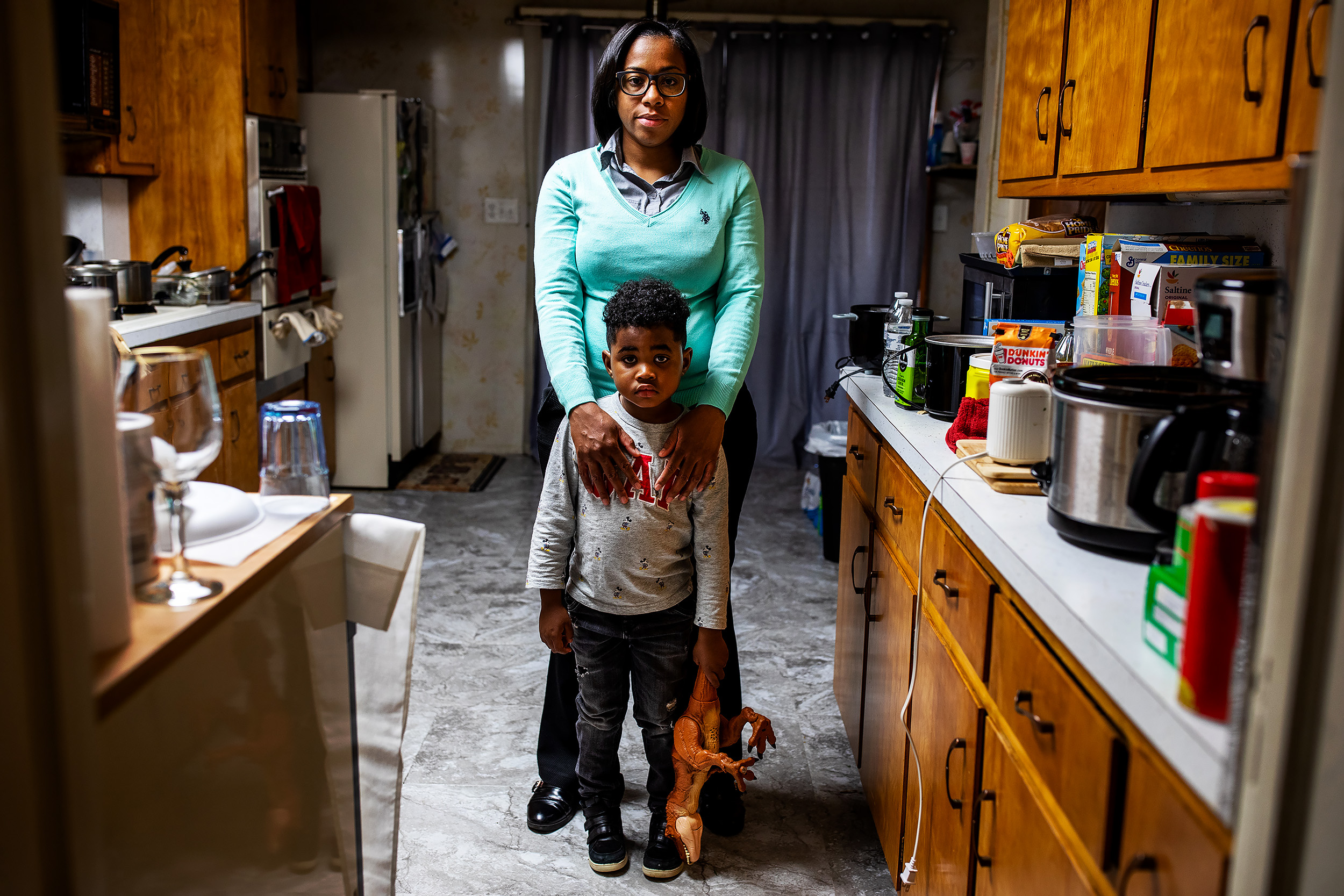Shakima Thomas with her son Bryce at her home in Newark, New Jersey. Shakima's home water pipe was recently replaced. Newark is still in the process of fixing the corrosion control treatment process at the Pequannock plant, which is contributing to the elevated lead levels.