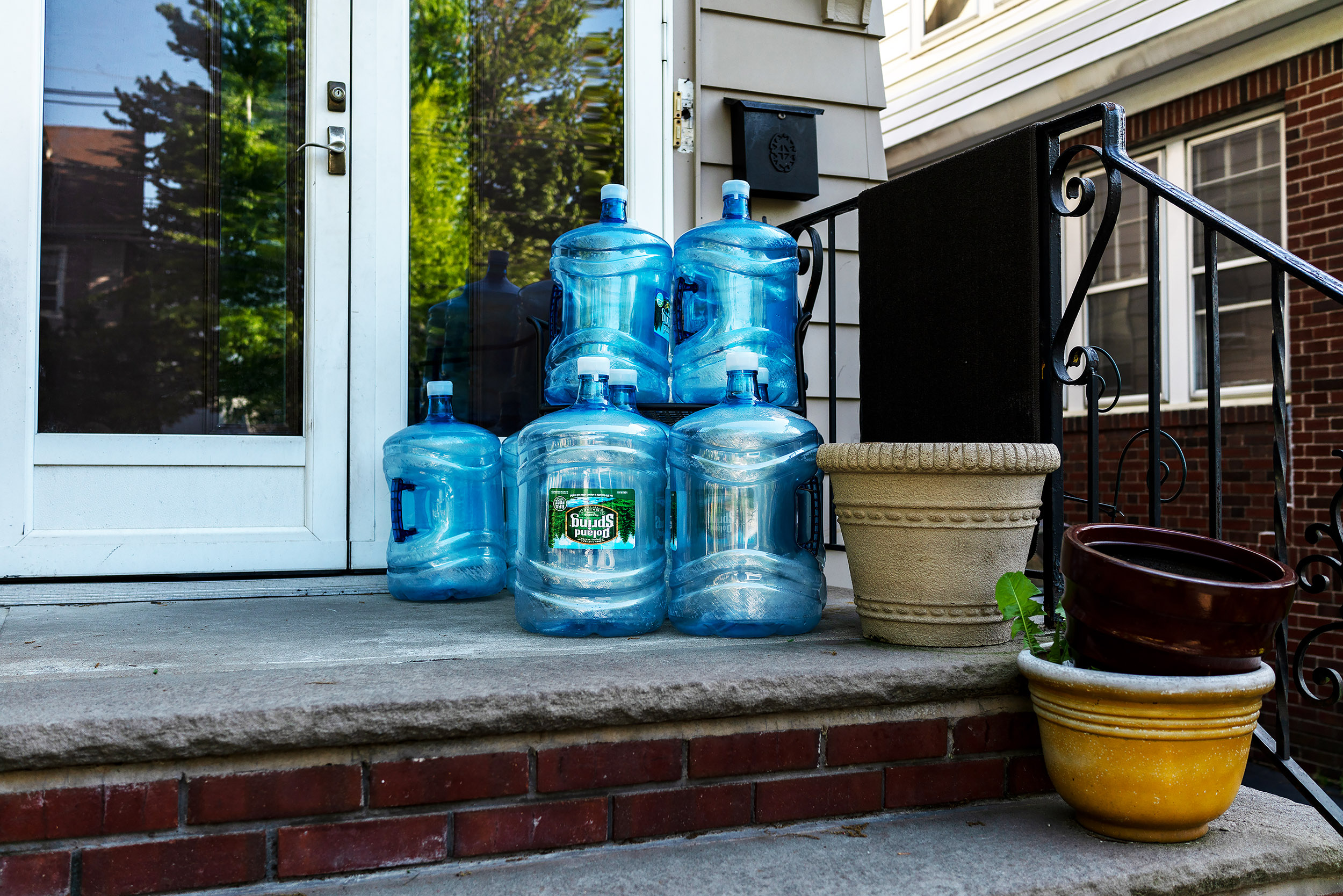 Water bottles awaiting pickup on the porch of a Newark home.