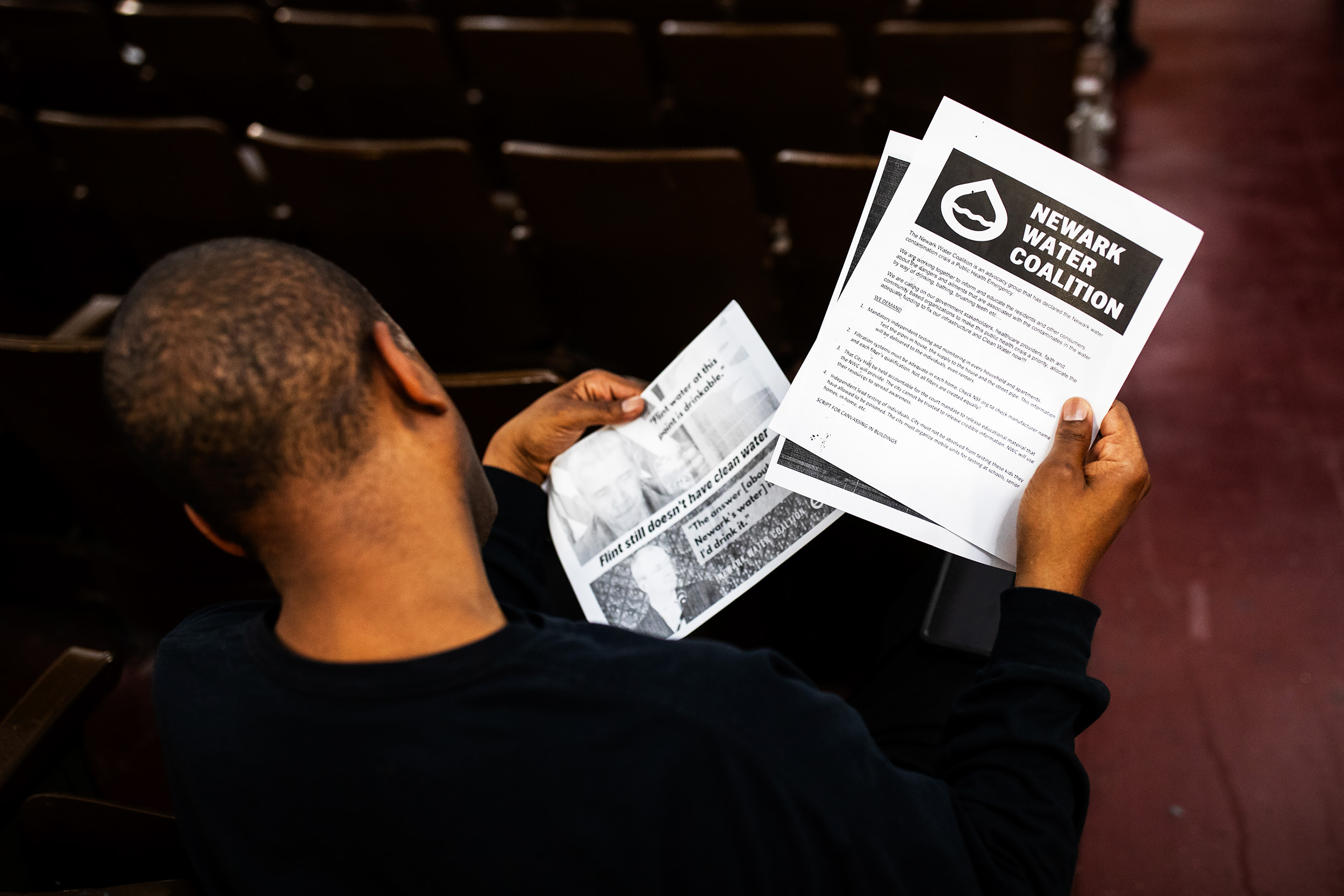 Residents look over handout materials and listen to presentations.
