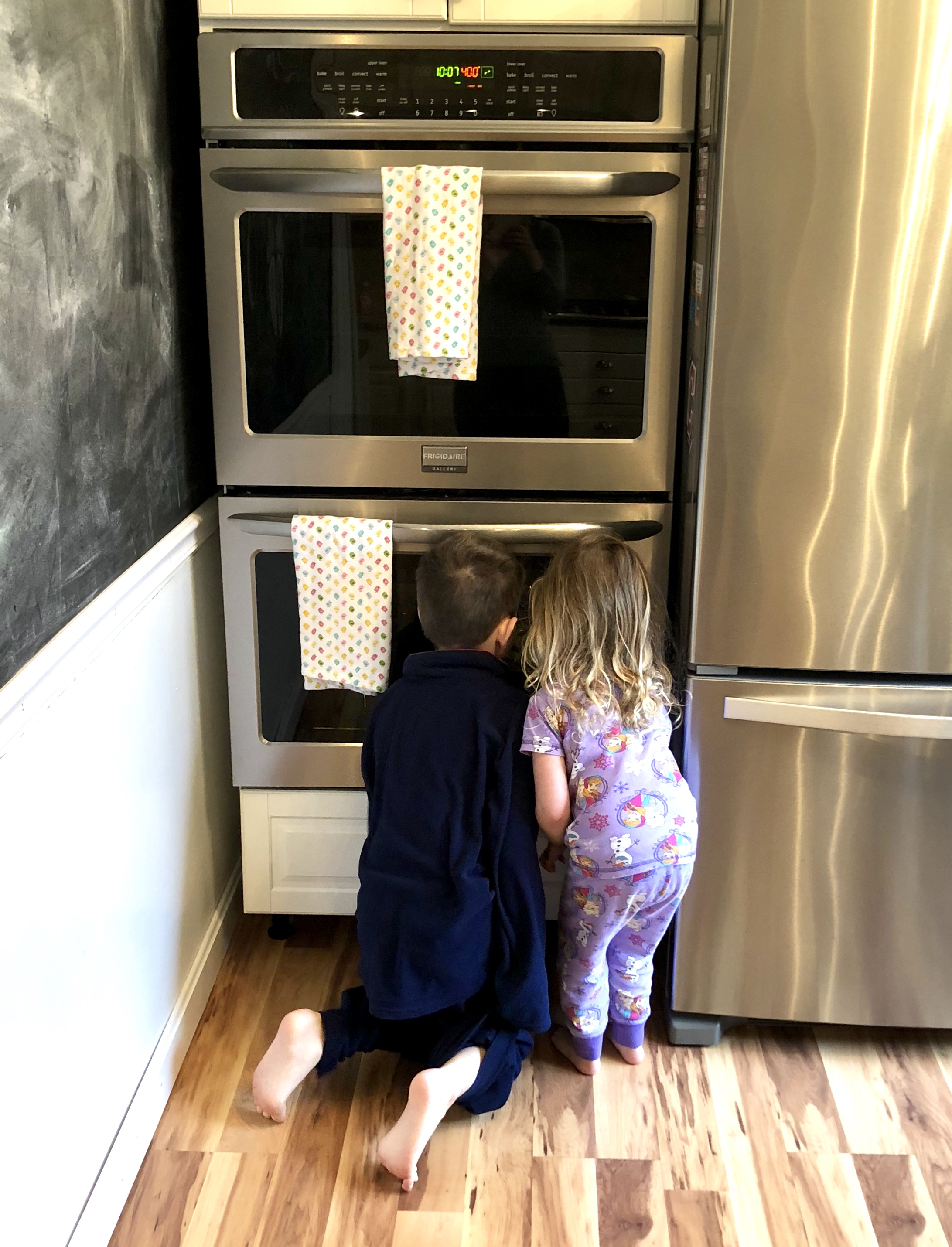 Kiddos waiting impatiently for their muffins to bake