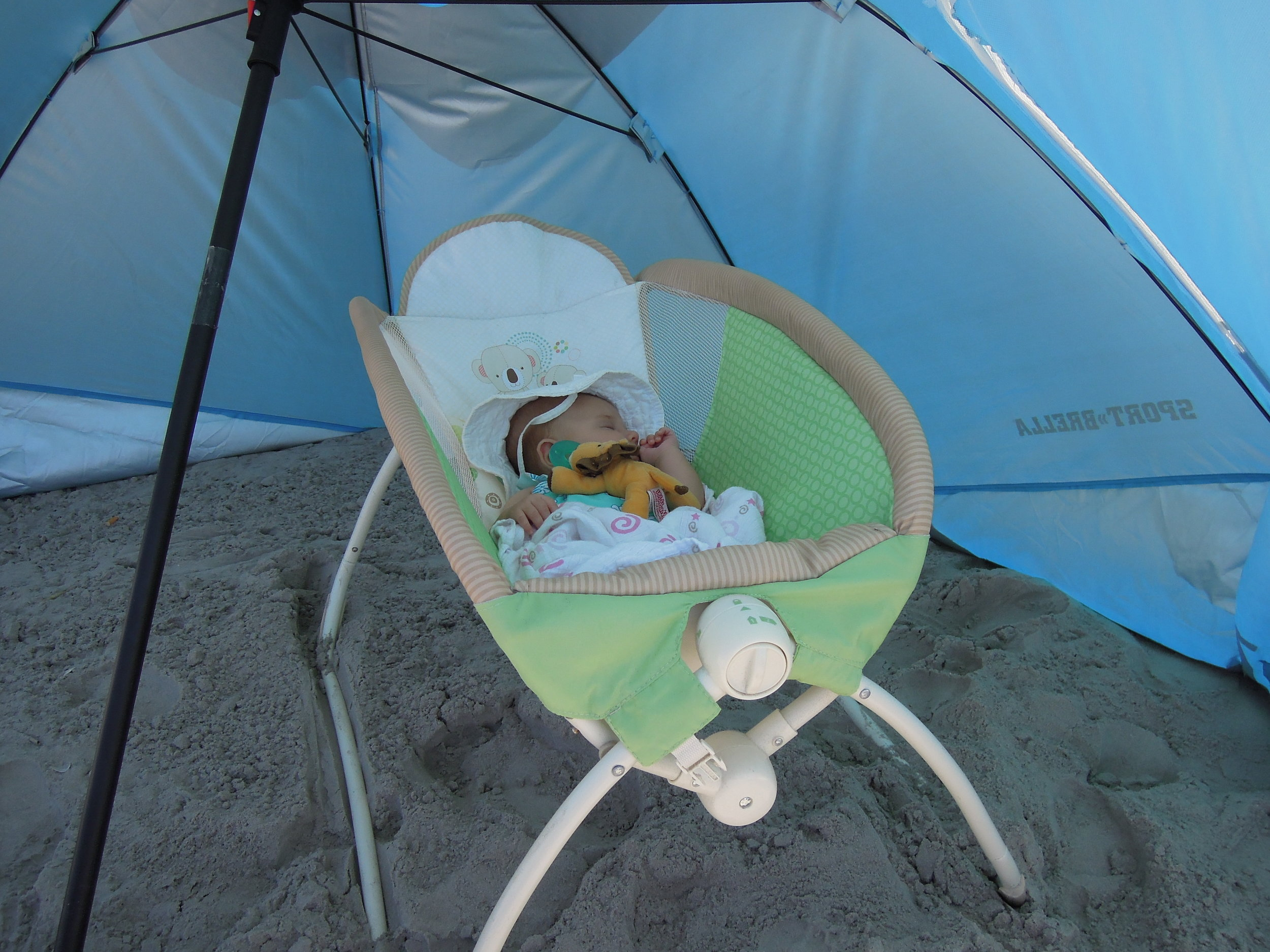 Baby Madeline sleeping blissfully under the Sport-brella