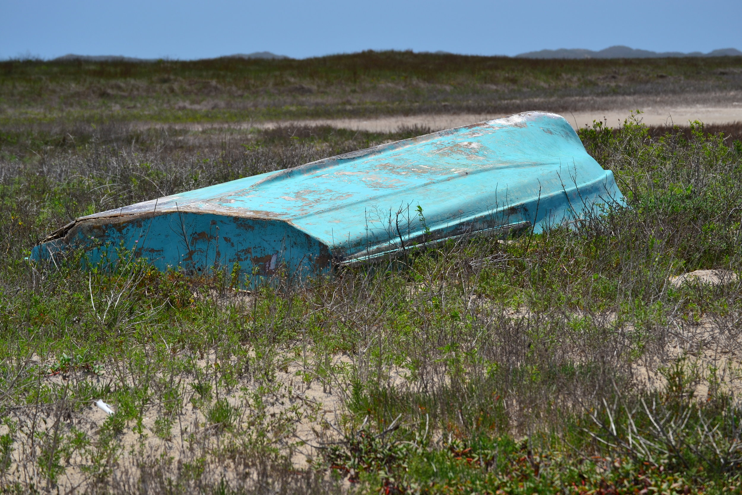 Storm wrecked boat on Cuba Island, a long ways behind the foredune ridge.