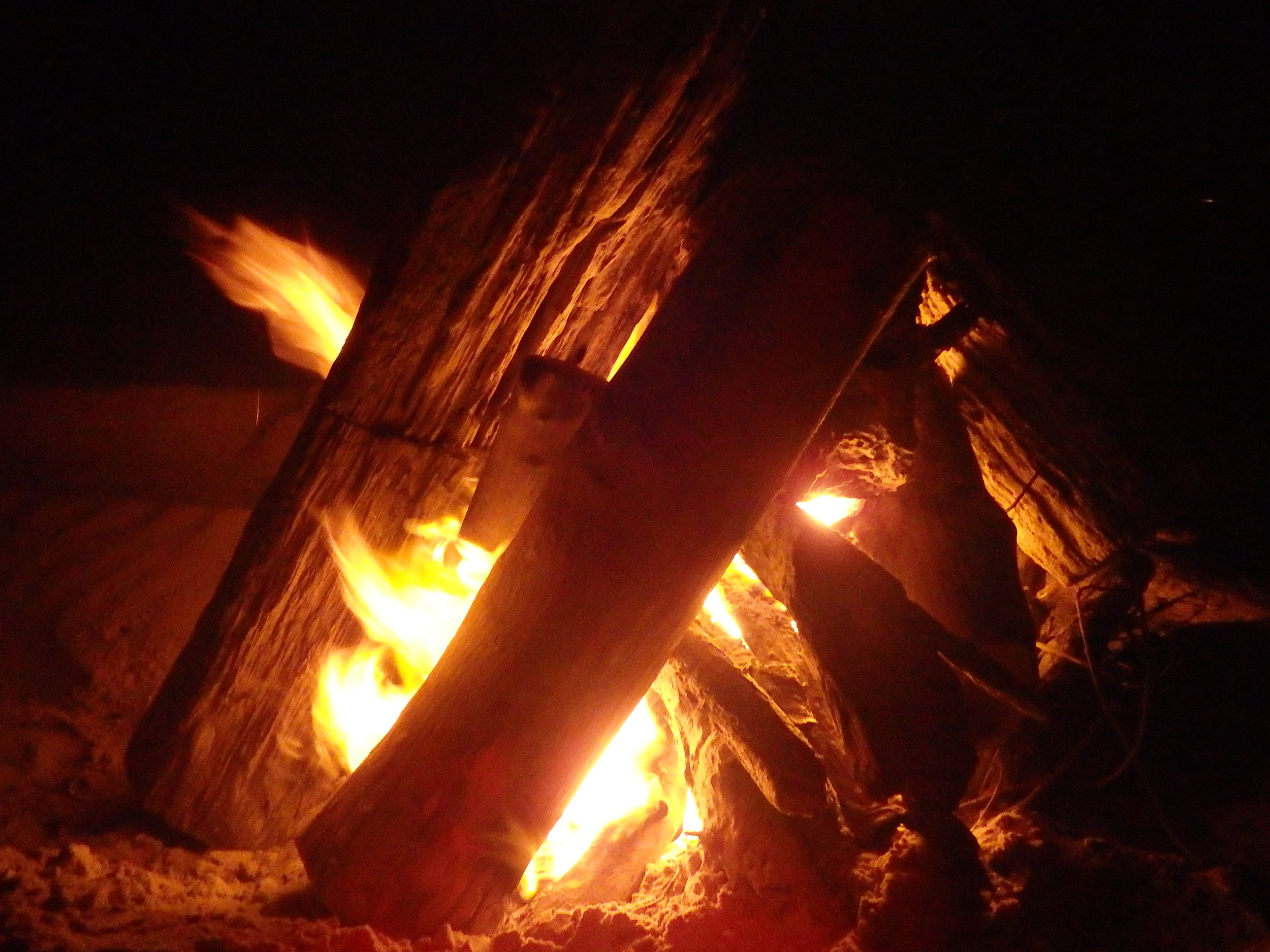 A good campfire can make the night in winter on Padre while camping.