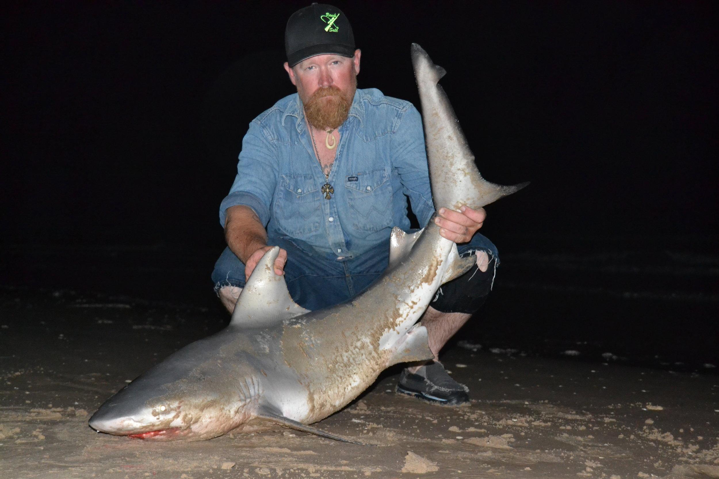 Nathan Sadosky with a casted bait bull shark.
