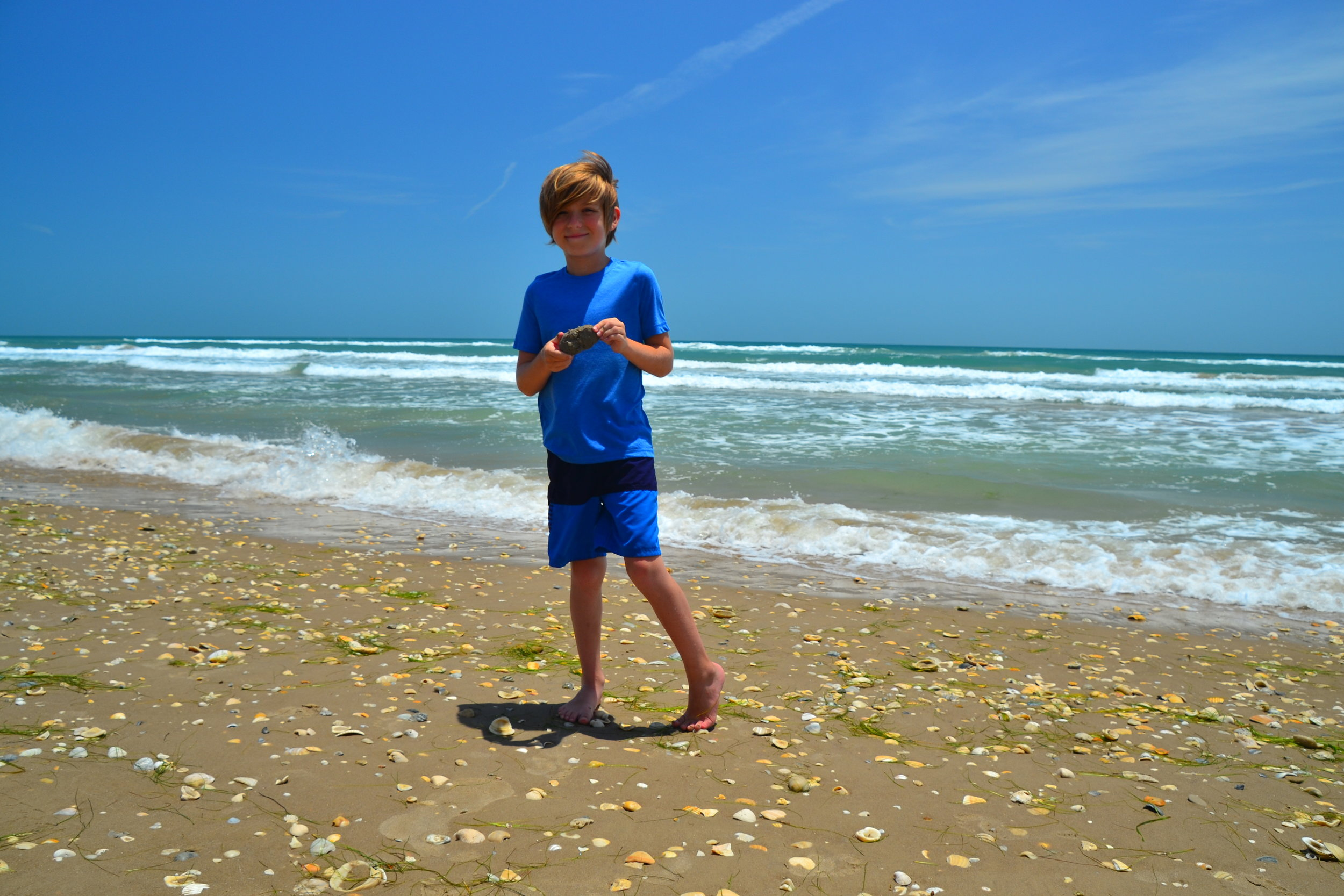 Grayson with a washed in piece of Beaumont clay from the offshore seabed!