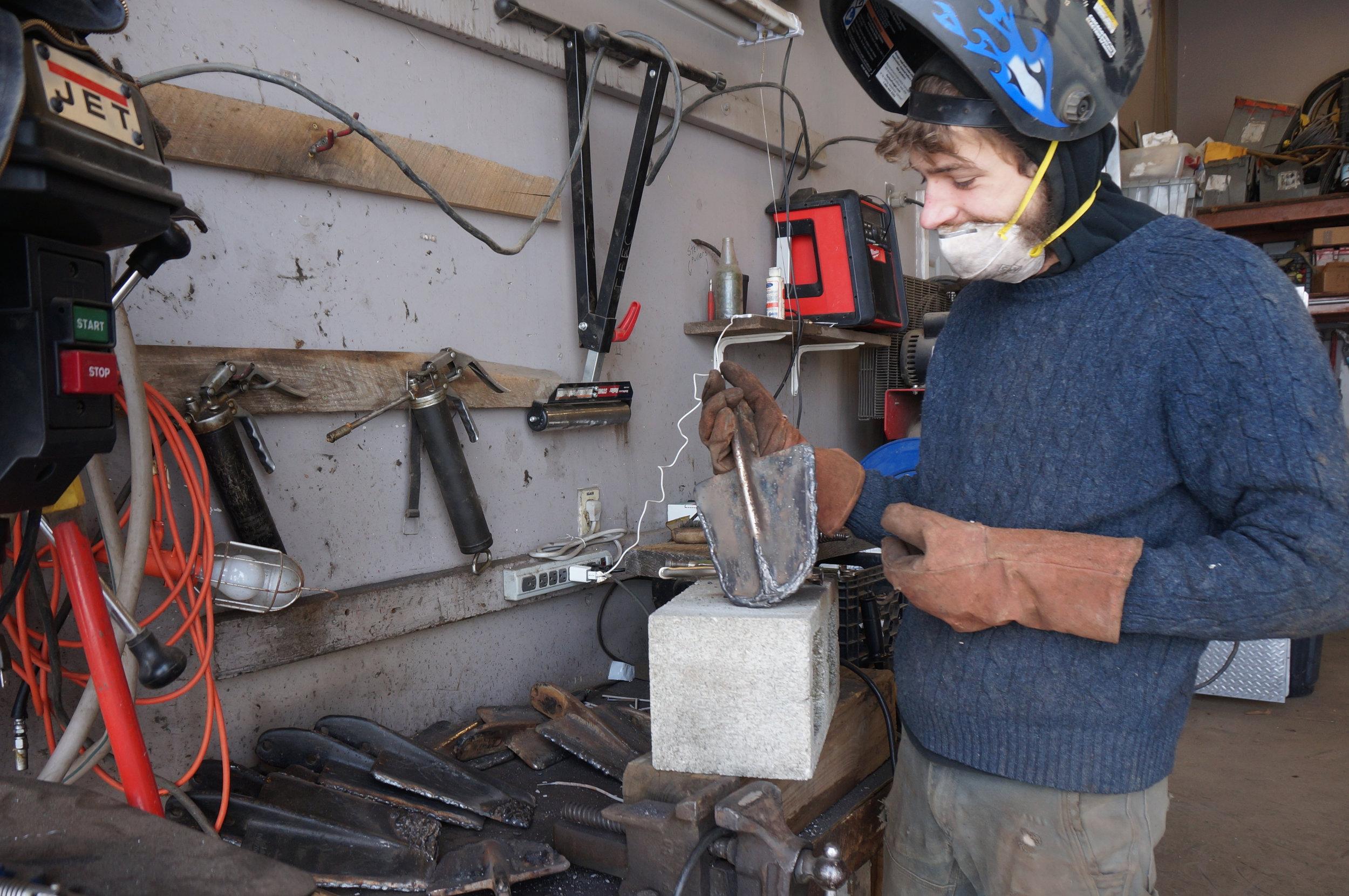 Sam Thomas inspecting worn spade