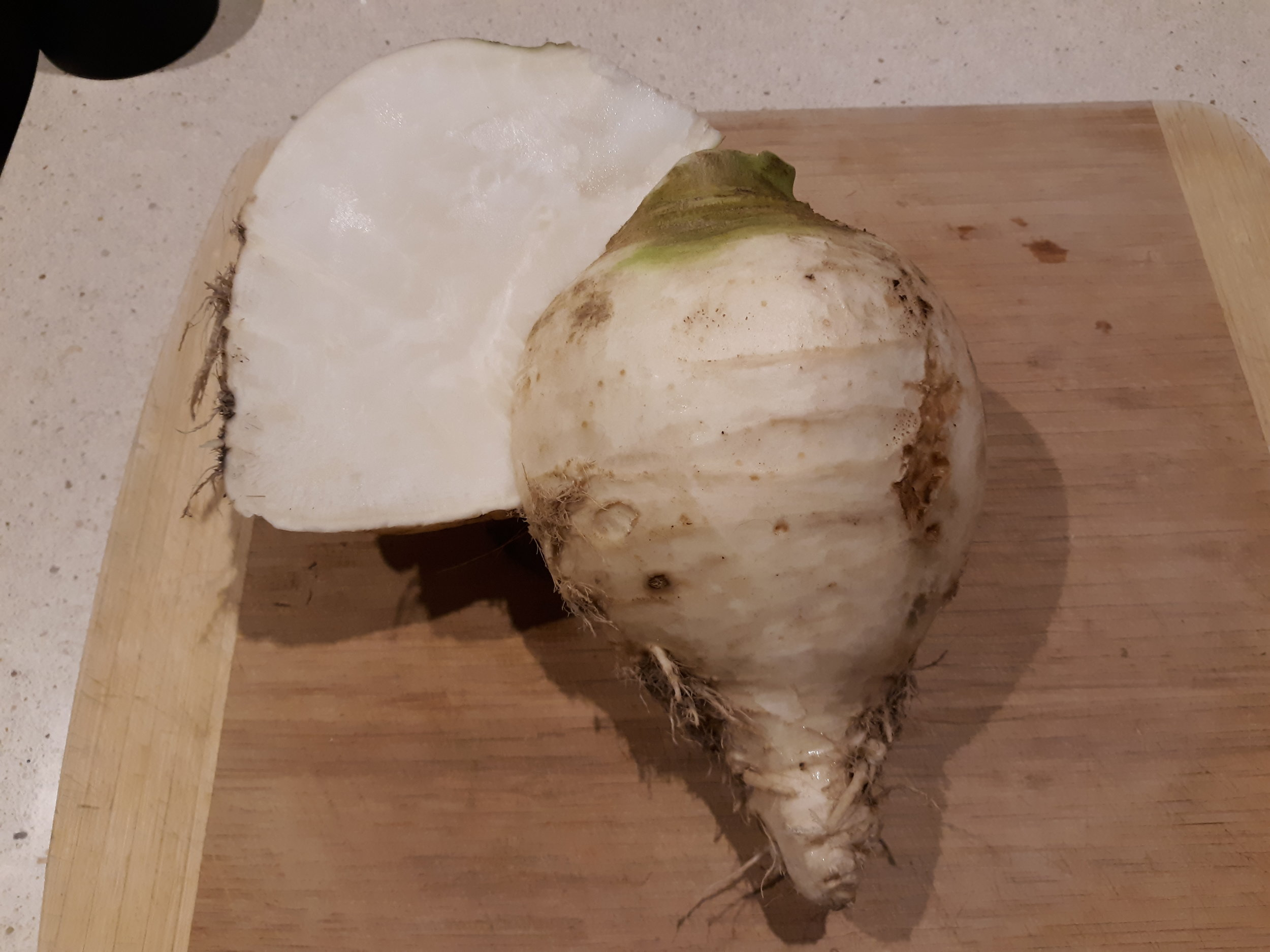Cut in half and ready to peel and eat raw.